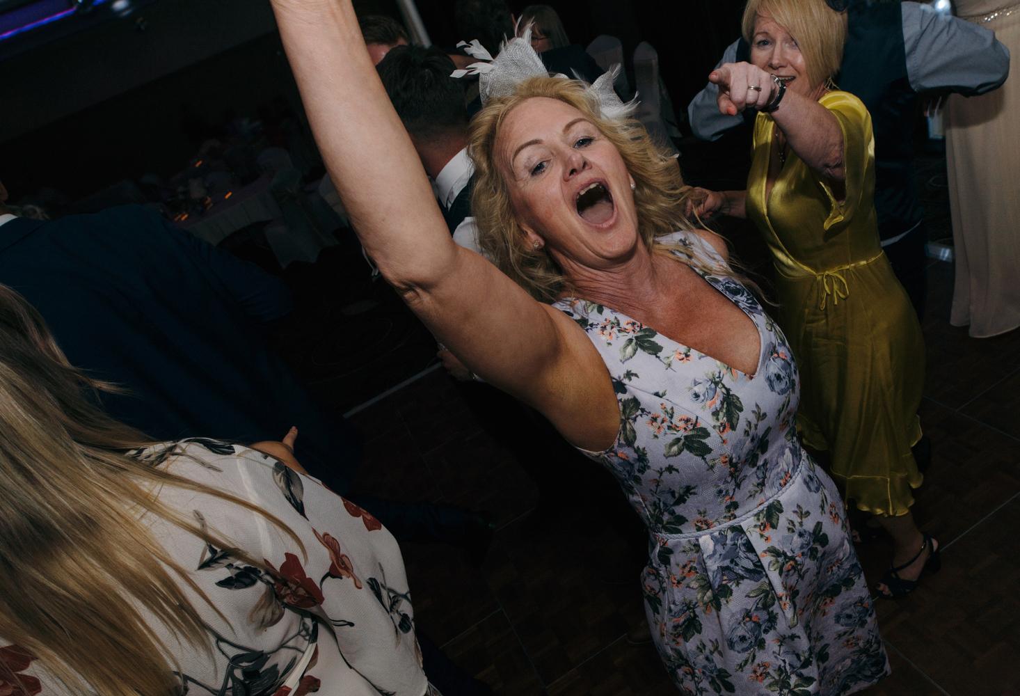 One of the wedding guests really enjoying herself on the dancefloor