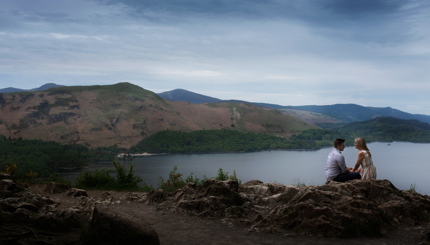 Pre shoot - A couple sitting chatting overlooking Derwent water in the Lake District