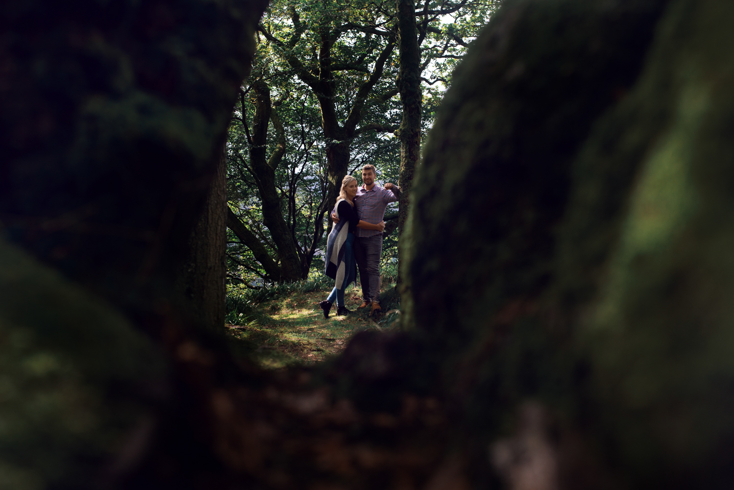 Pre shoot - A couple standing in the woods near Derwent water in the Lake District