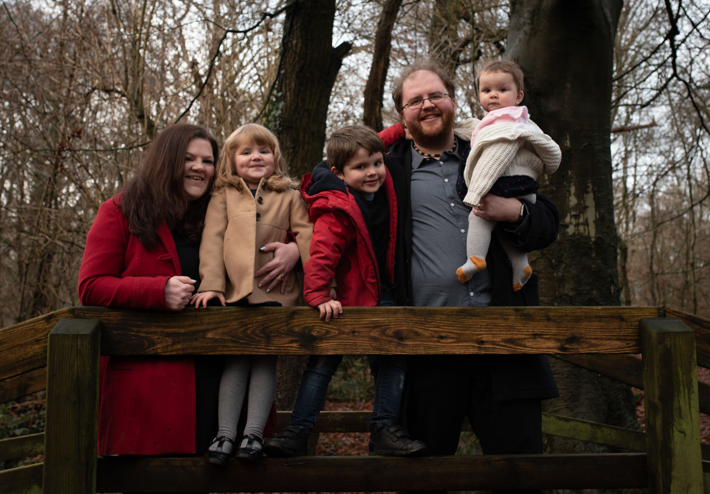 Nice family group photograph in the woods