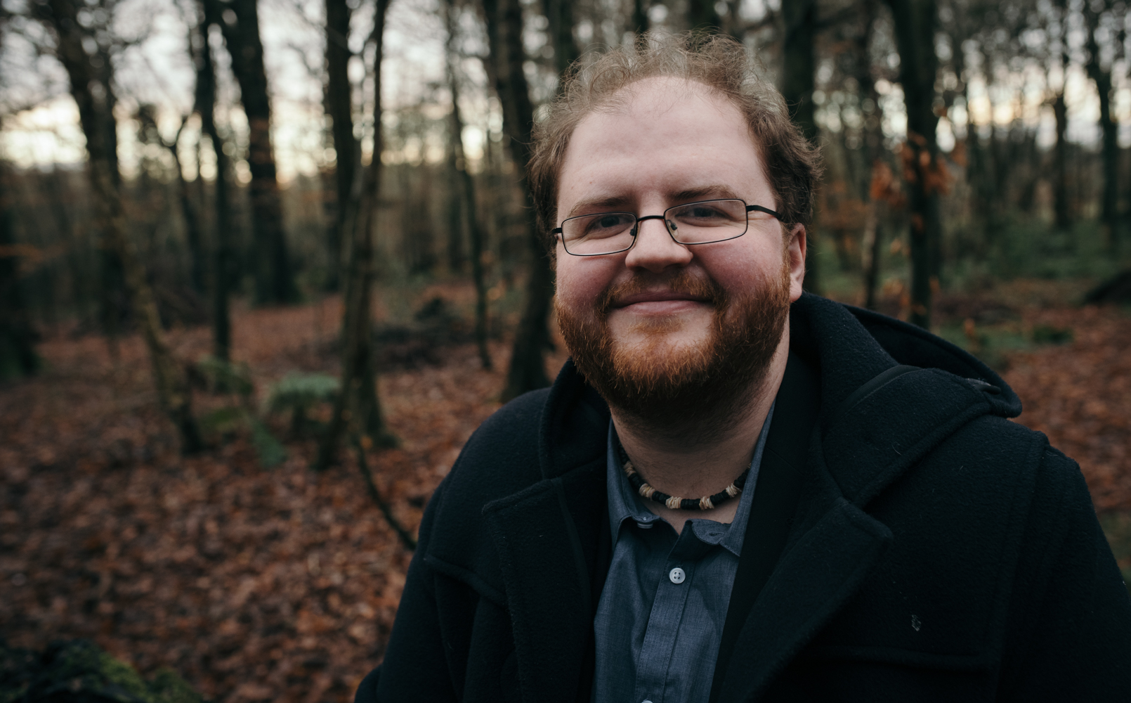 A portrait photograph of Russ in the woods
