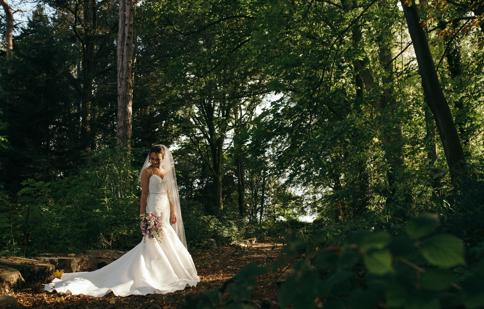The bride on her own during the couples portrait session