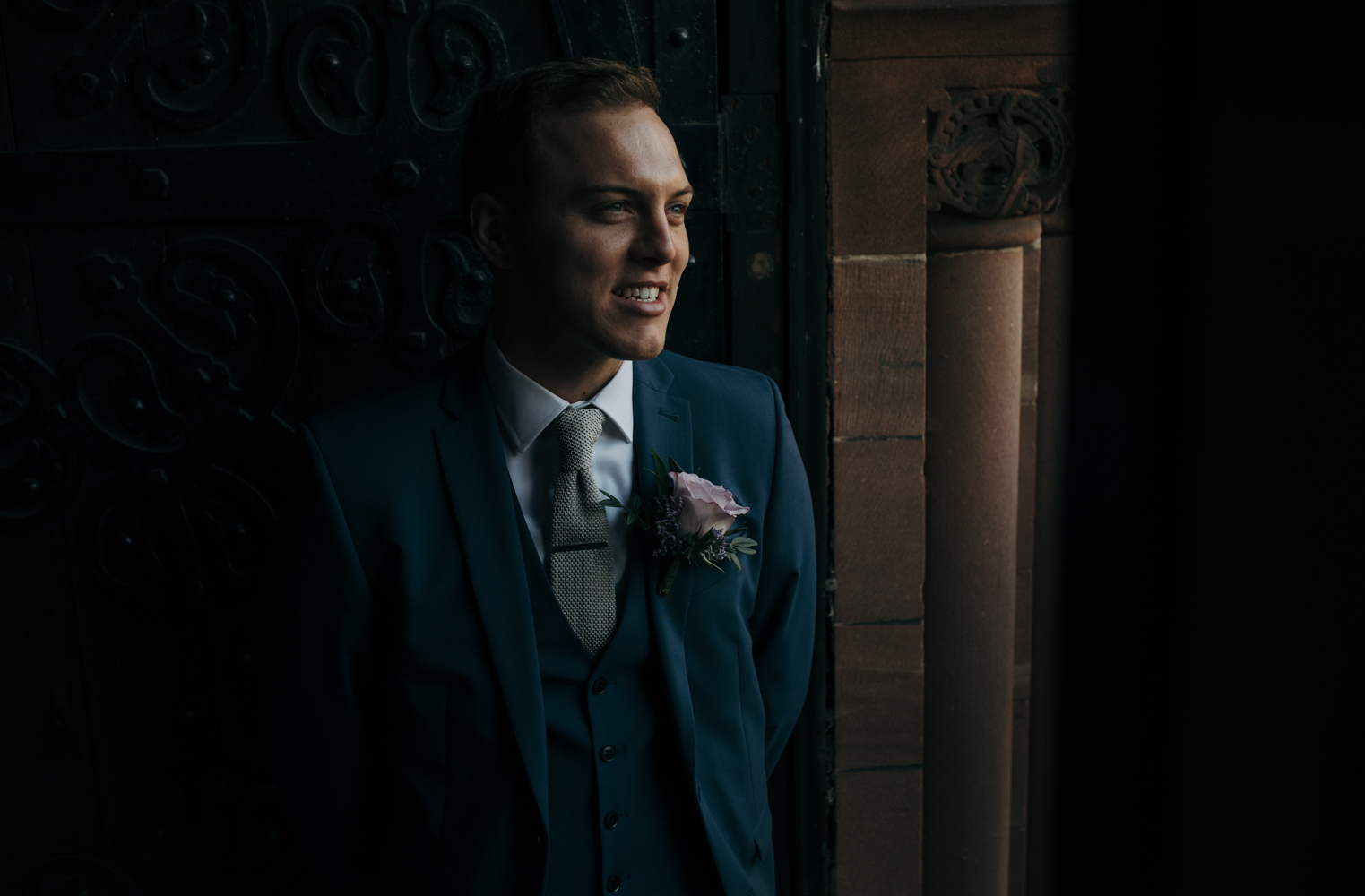 The groom waiting to welcome wedding guests