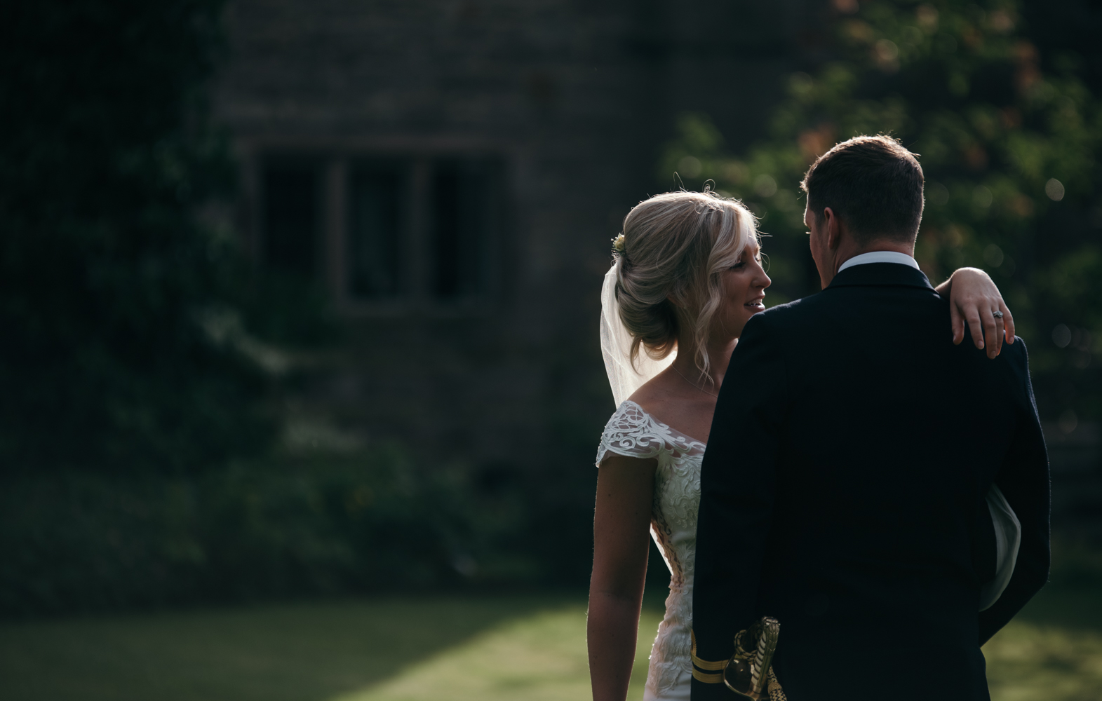 Bride and groom portrait in the early evening sunlight