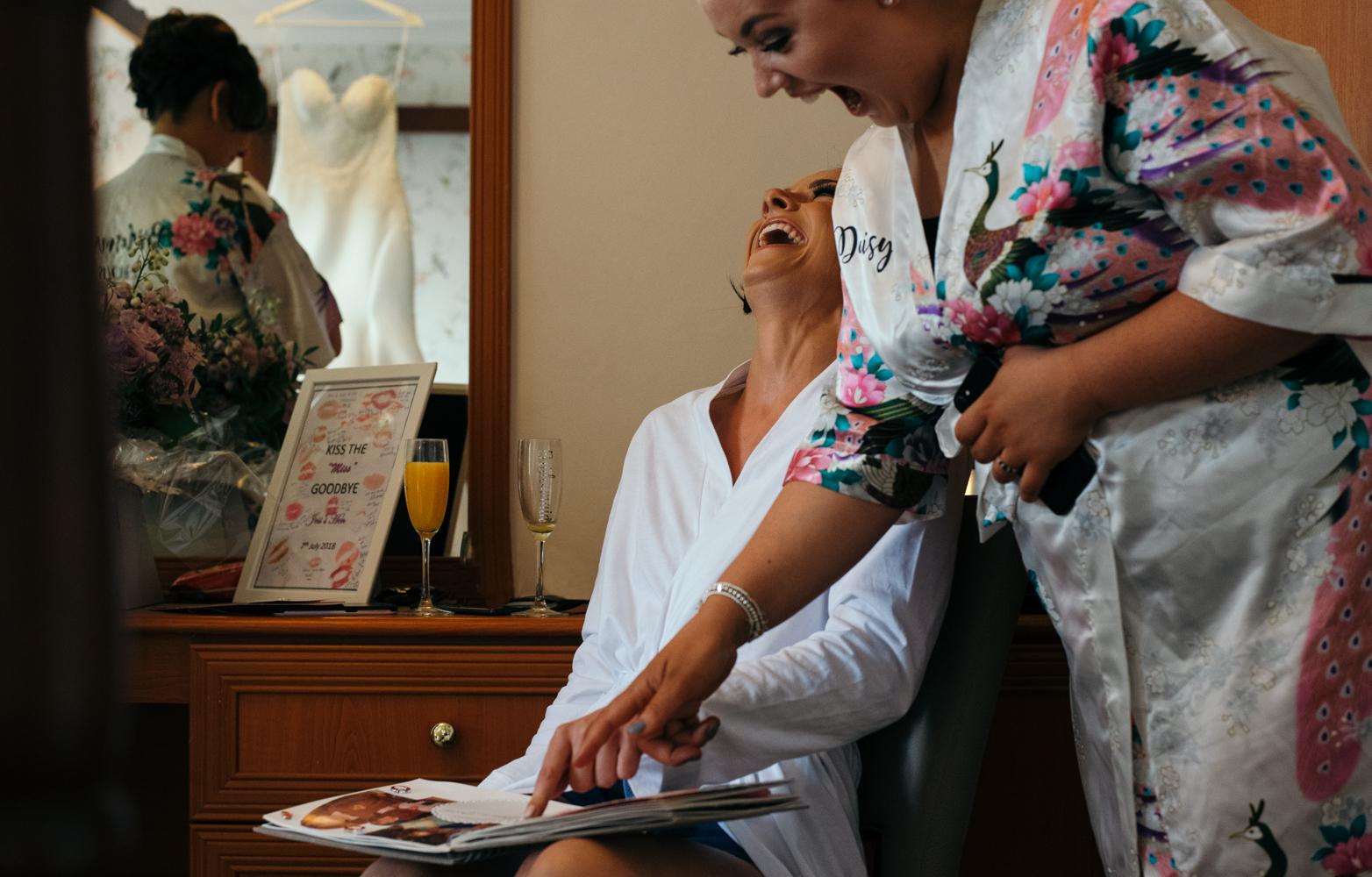 Bride laughing during morning preps.jpg