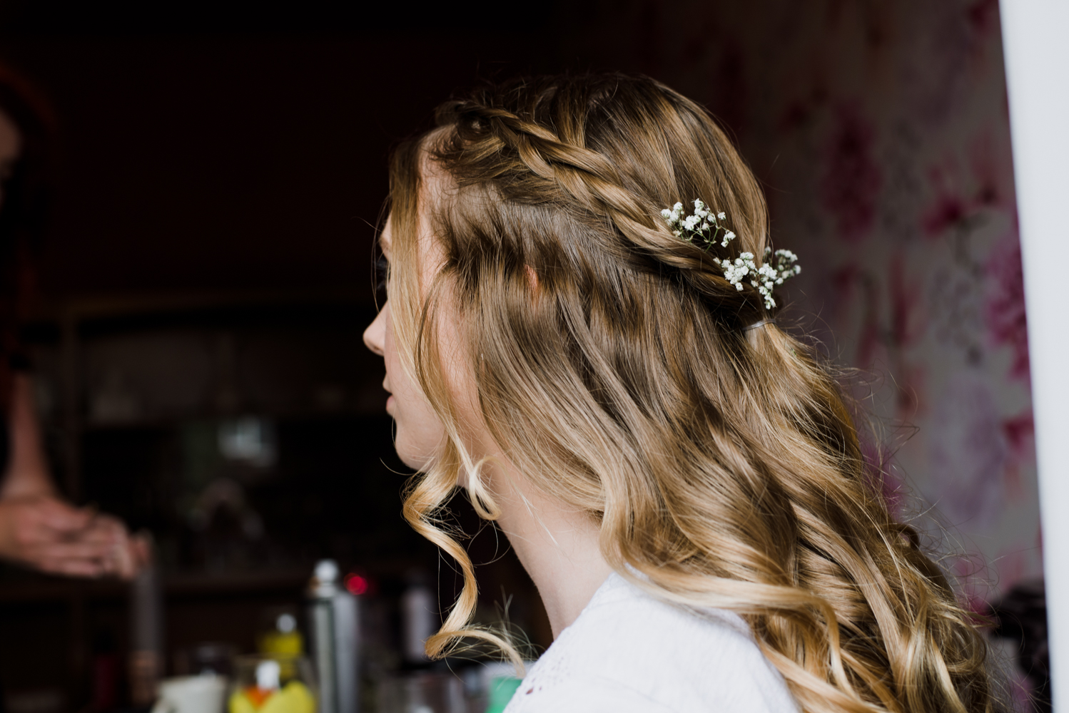 A detail photo of one of the bridesmaids hair