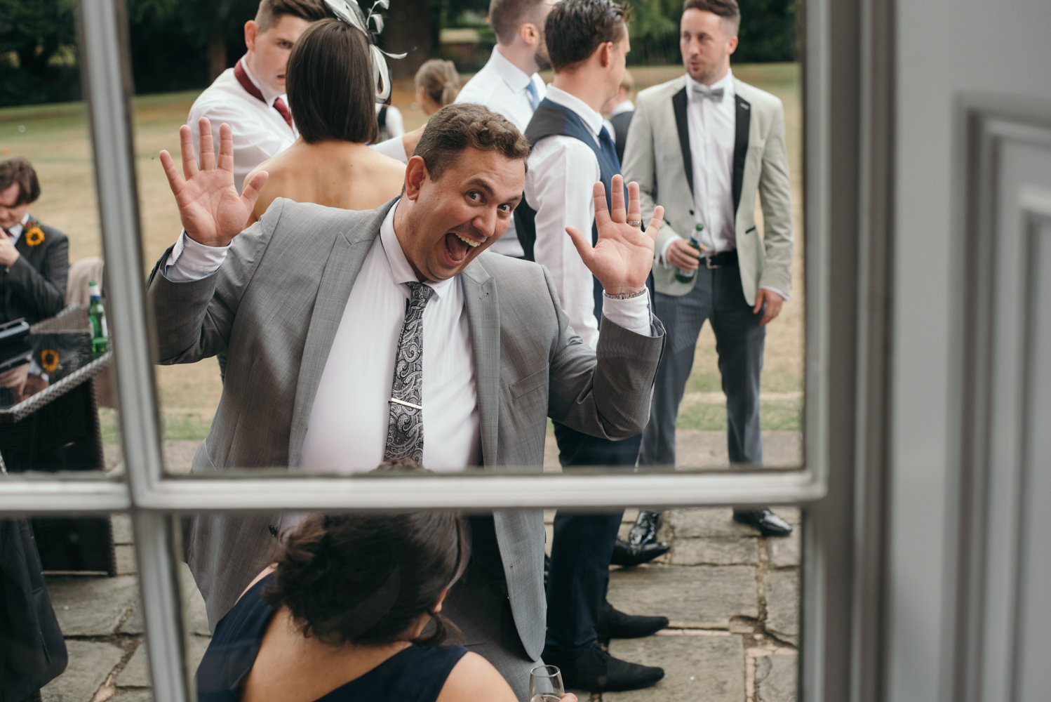 A male guest pulling a funny face during the drinks reception