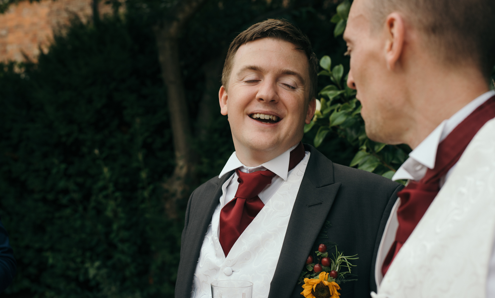 The best man chatting to guests