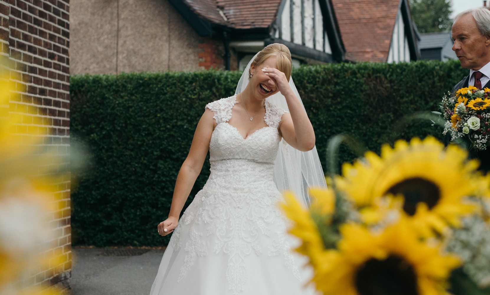 The bride waiting to go into the church having a laugh