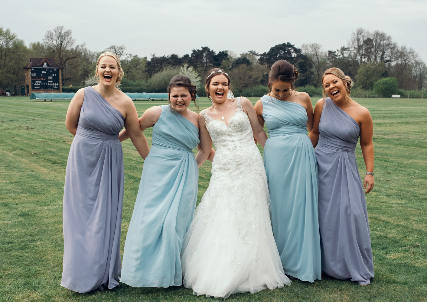 The bride and bridesmaids having a laugh during groups shots