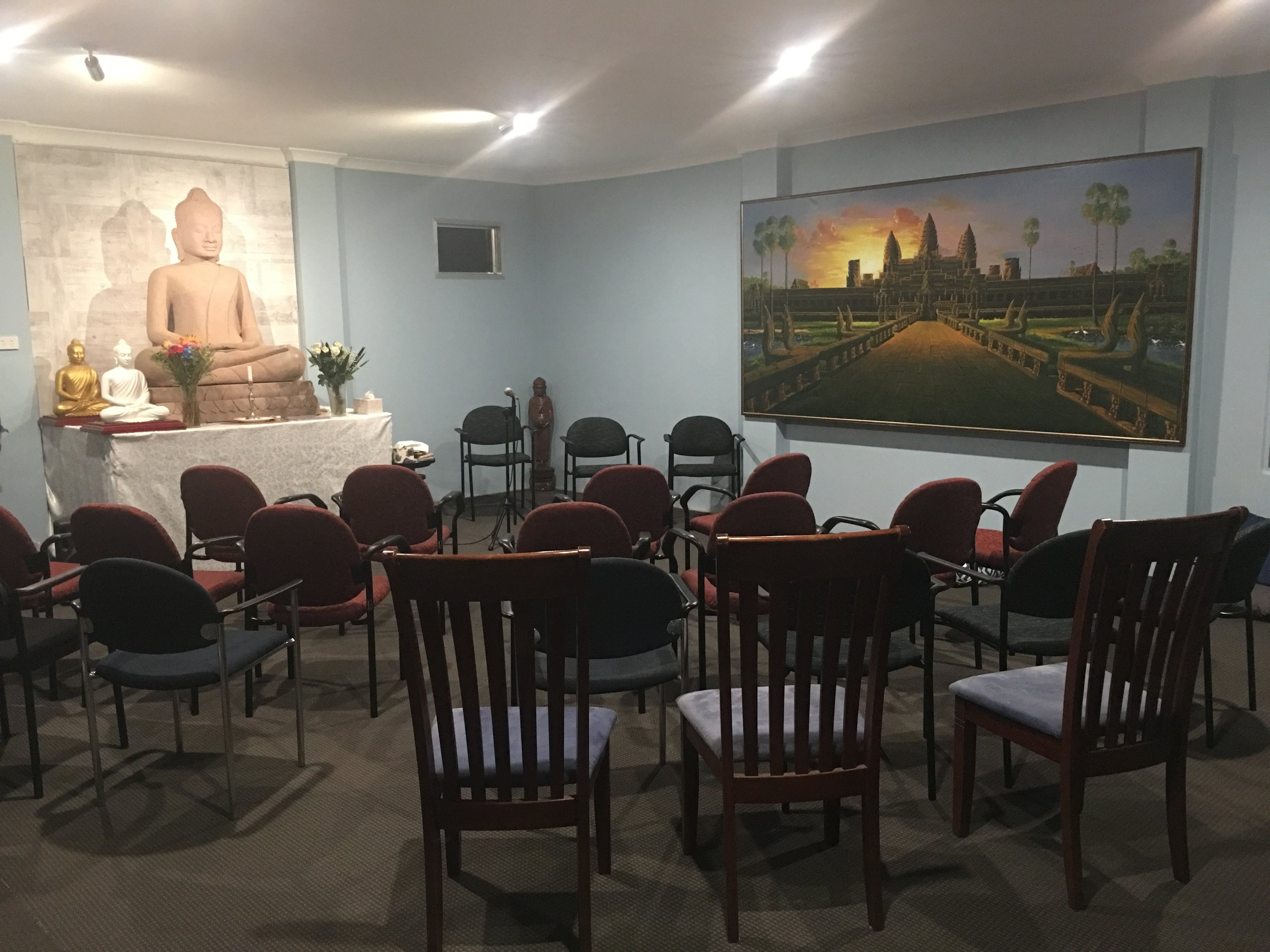 Getting the seating in the Vihara ready for the Meditation conducted by Ajahn Khemavaro on Monday on 27 May 2019.