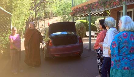 Ajahn Brahm arrived back from a house dana. We were very happy to see him. One of us was really excited about seeing him in person for the first time after she has been listening to his Dhamma talks on the website for some time.