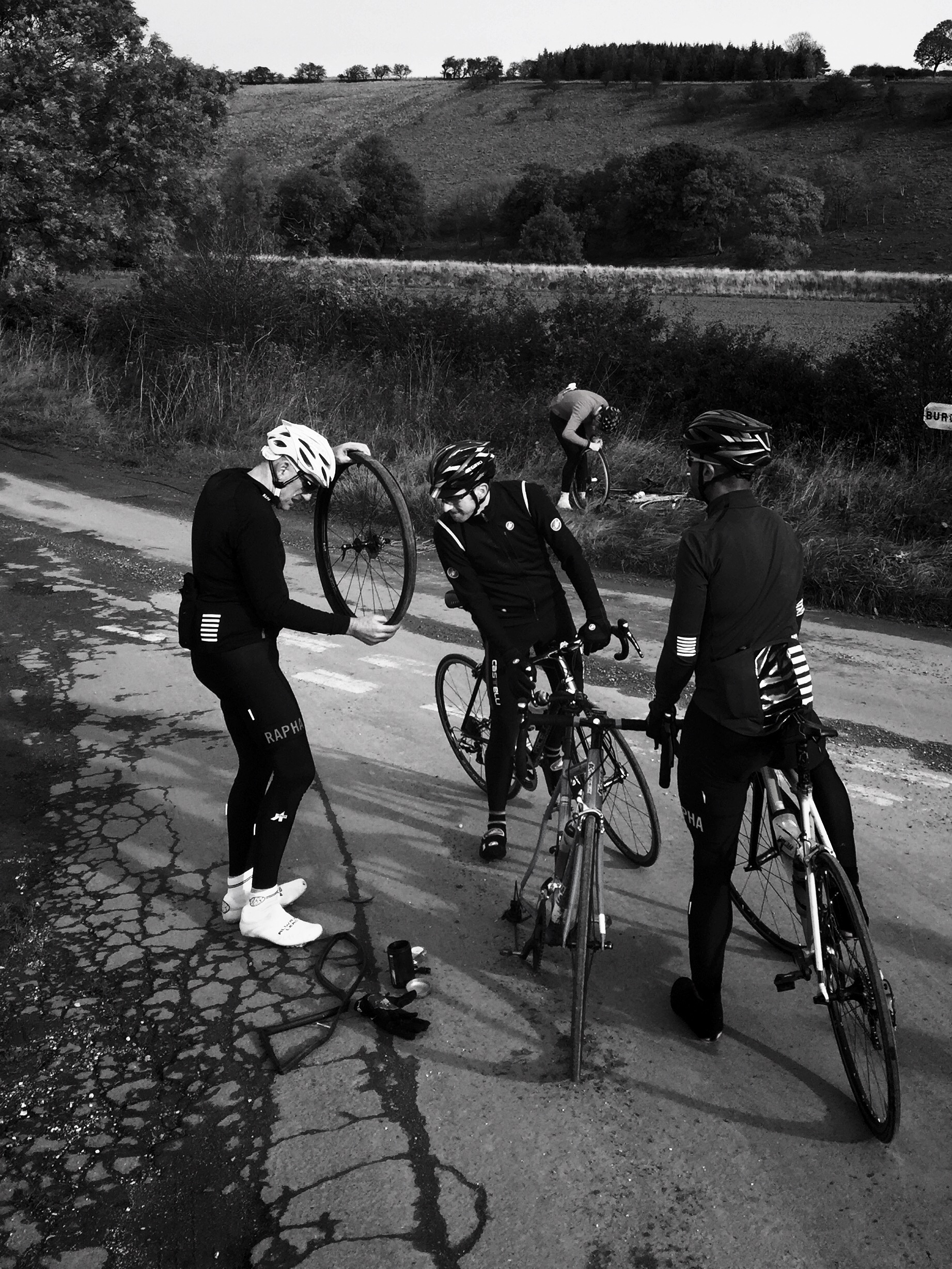 Puncture, and another puncture in the background. There were 10 punctures within four miles for this group.