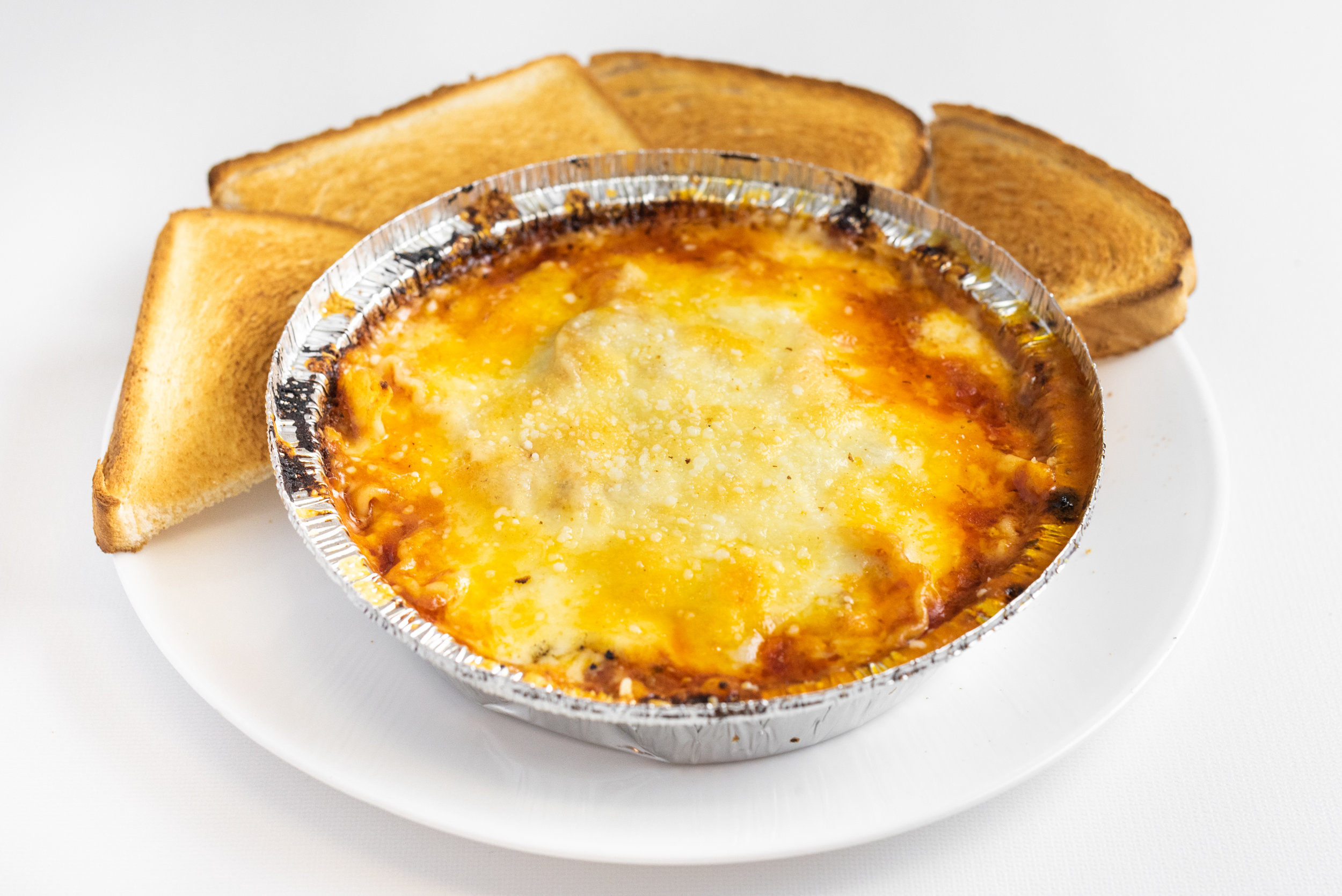 VarsityPizza_Subs(VarsityDr.NW)_Lasagna.jpg