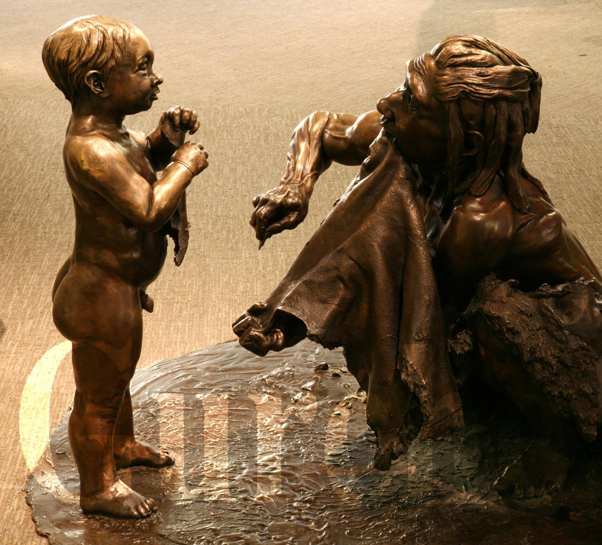 Image 801 Neandertal mother and child Smithsonian bronze.jpg