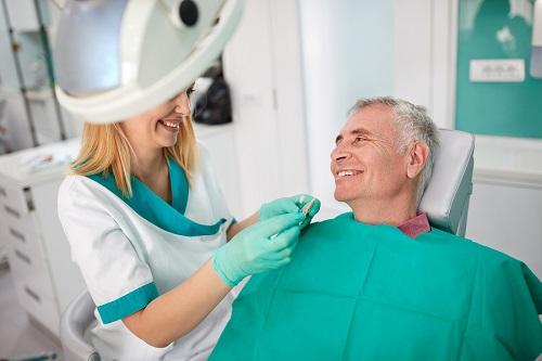bigstock-Female-dentist-strives-to-find-145449833.jpg