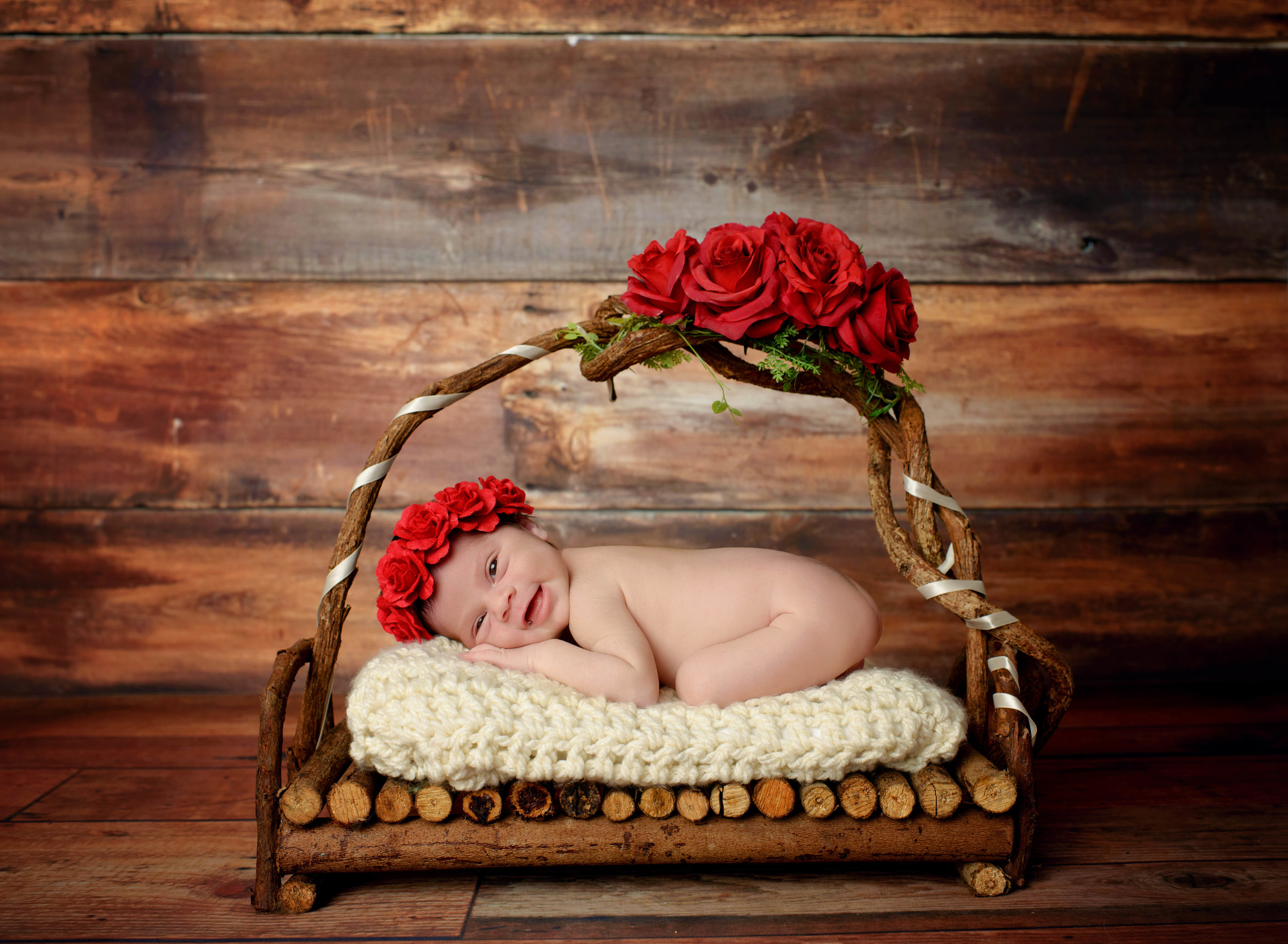 Newborn bed with roses