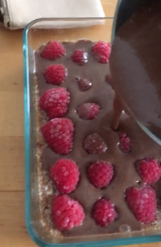 Pour choc-fudge mixture over raspberries and place in fridge to set