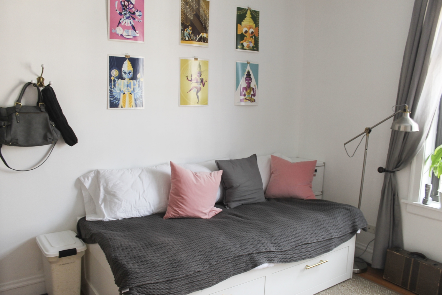 After | Daybed -  Ikea  with replaced  handles  | Wall Art - ' The Big Book of Hindu Deities by Sanjay Patel ' |Lamp -  Ikea  | Camera Bag - Target Purse