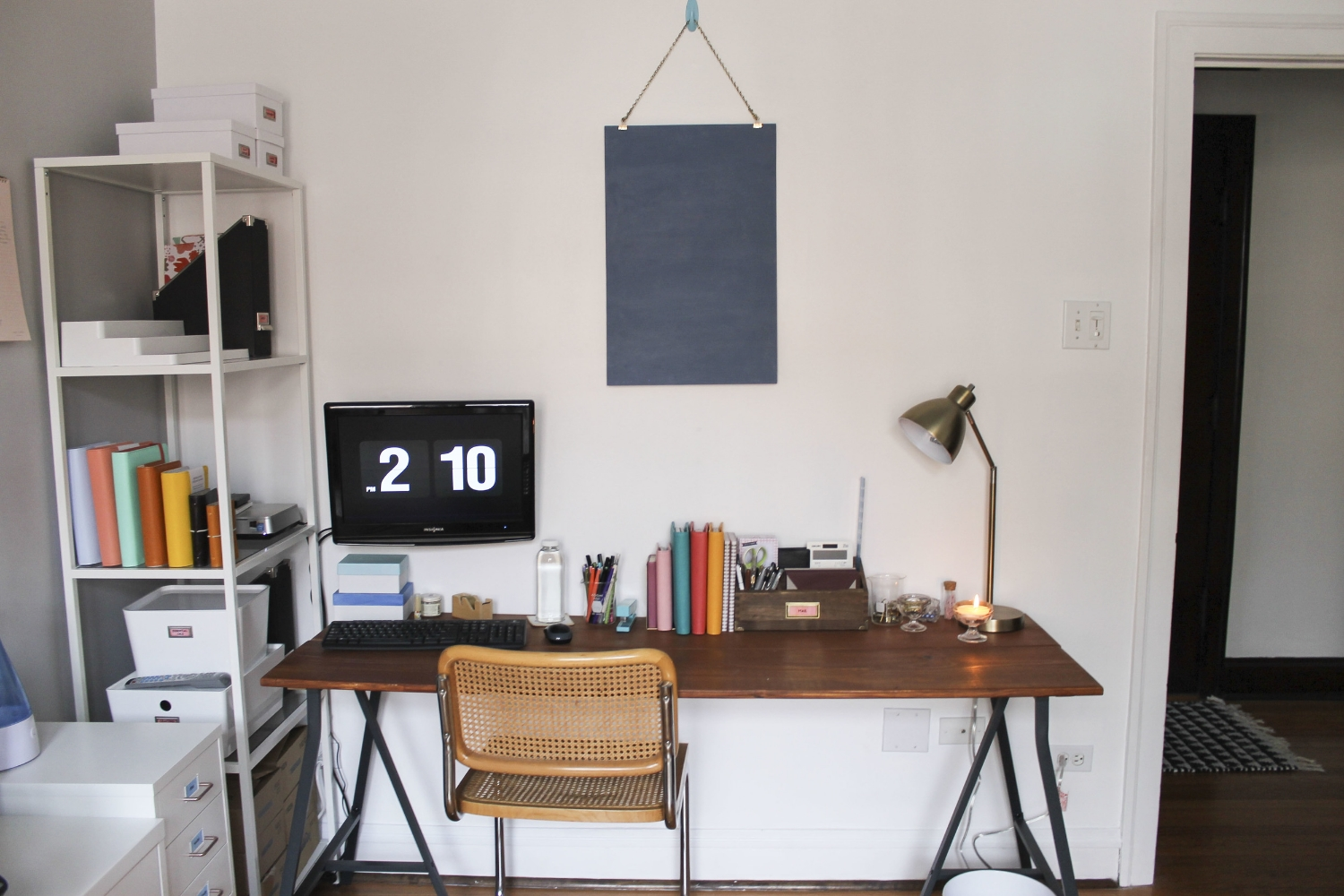 After | Desk - Handmade with reclaimed boards and  Ikea trestles  | Chair - Thrift store 'Cesca' knockoff | Shelving Unit -  Ikea  | Drawer Unit -  Helmer from Ikea