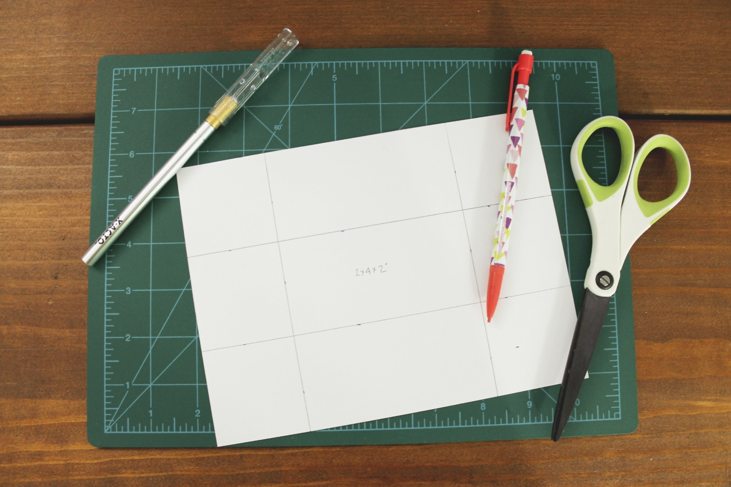 The cut out piece of scrapbook paper with the fold lines