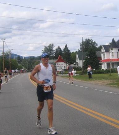 Peter crushing the run at Ironman lake Placid, 2004.