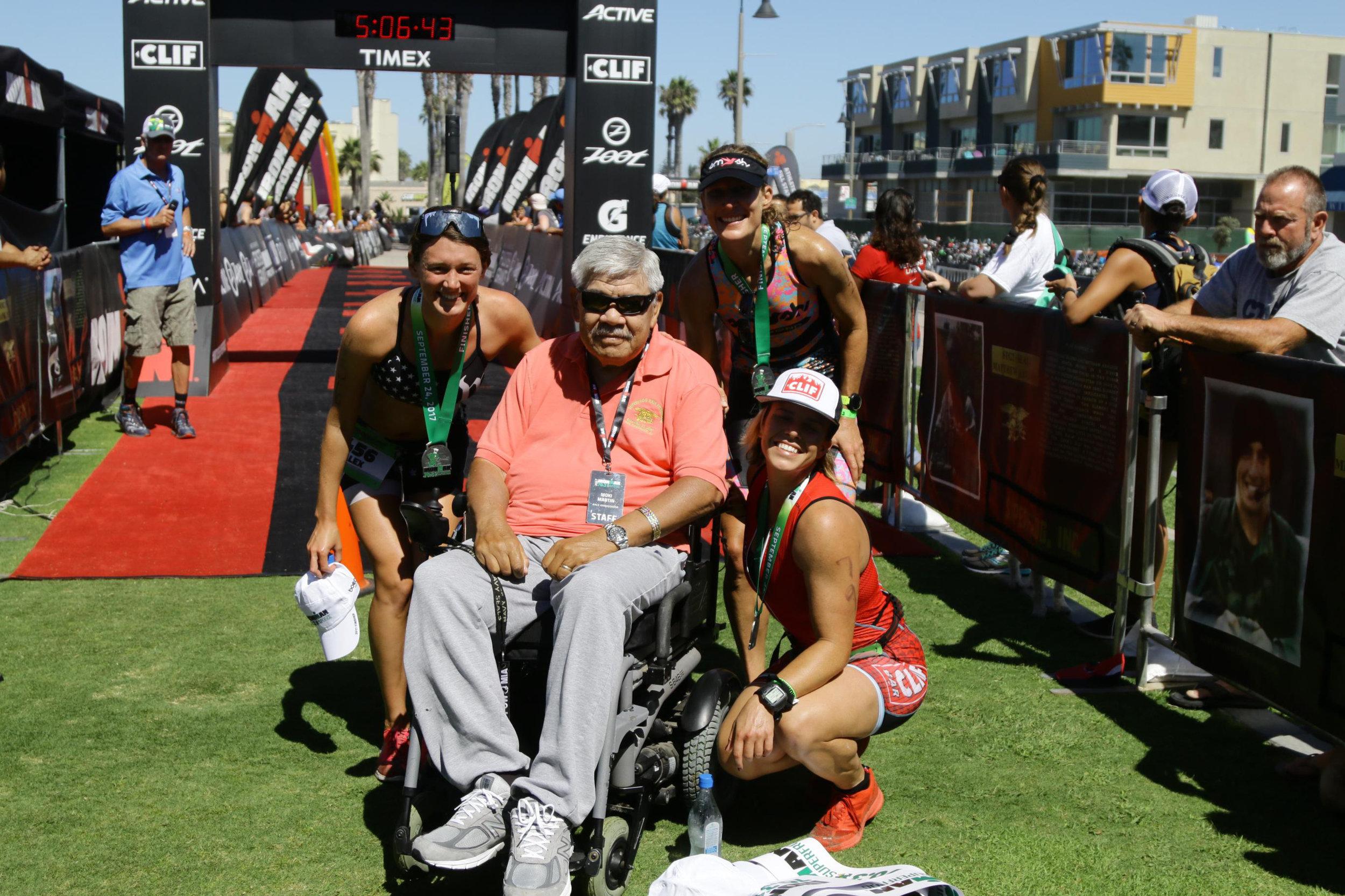 The top 3 women posing with the original race director, and legend, Moki Martin.