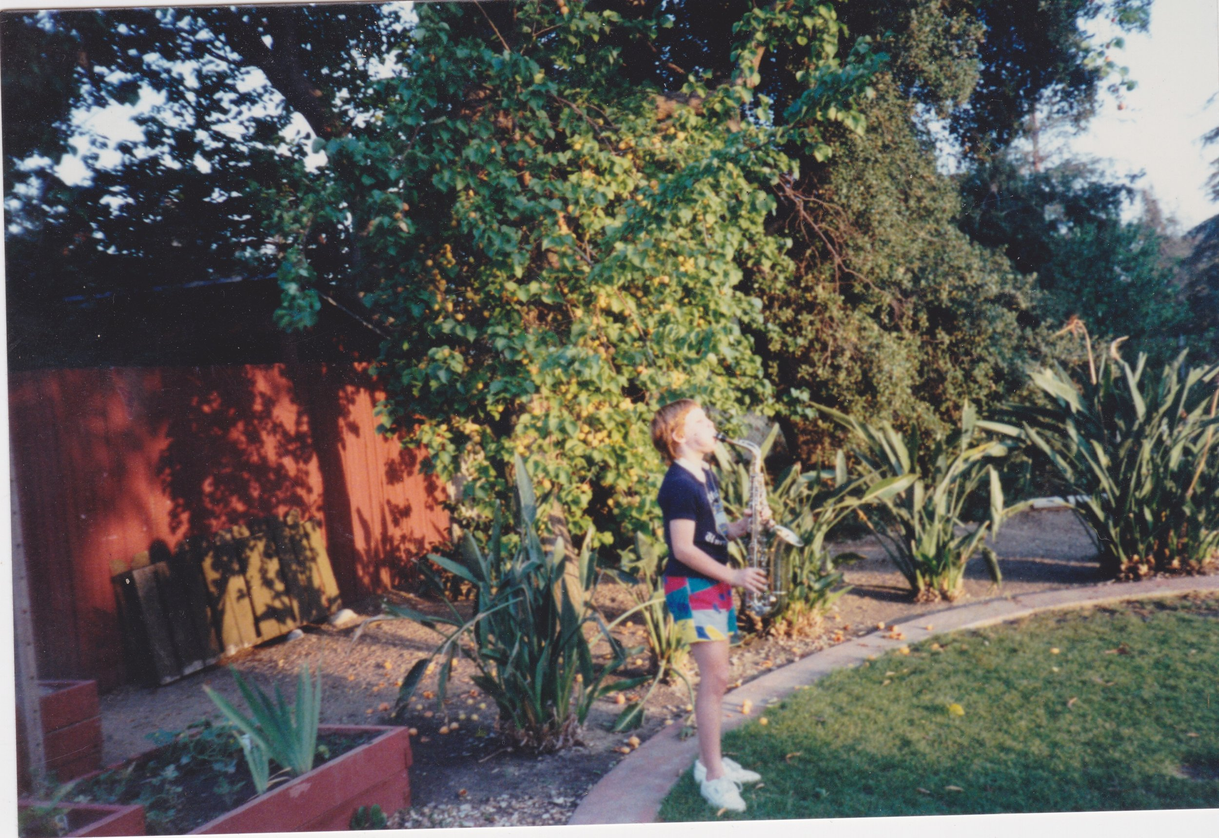 """Circa 1987, yours truly practicing the saxophone. This backyard stage would later be used as the set for my first talk show, """"Kelly"""",which ran for two seasons in 1989 - 1990.:)"""
