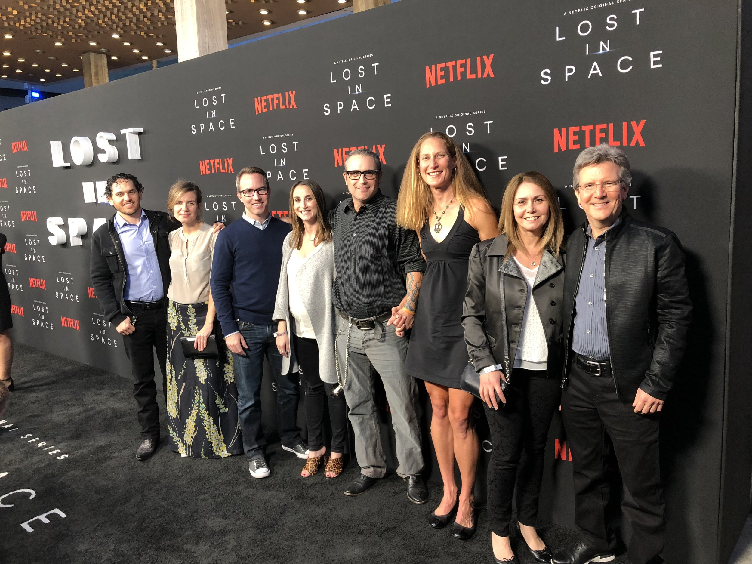 The Lost In Space VFX team and their teammates sneaking a photo on the step and repeat after the stars had all shuffled through. Thank you Netflix marketing team!