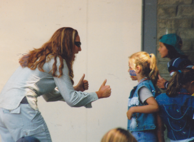 Nearly nineteen year old, Coach T pumping up her RHCDS's campers before their big end of camp performance in 1998.