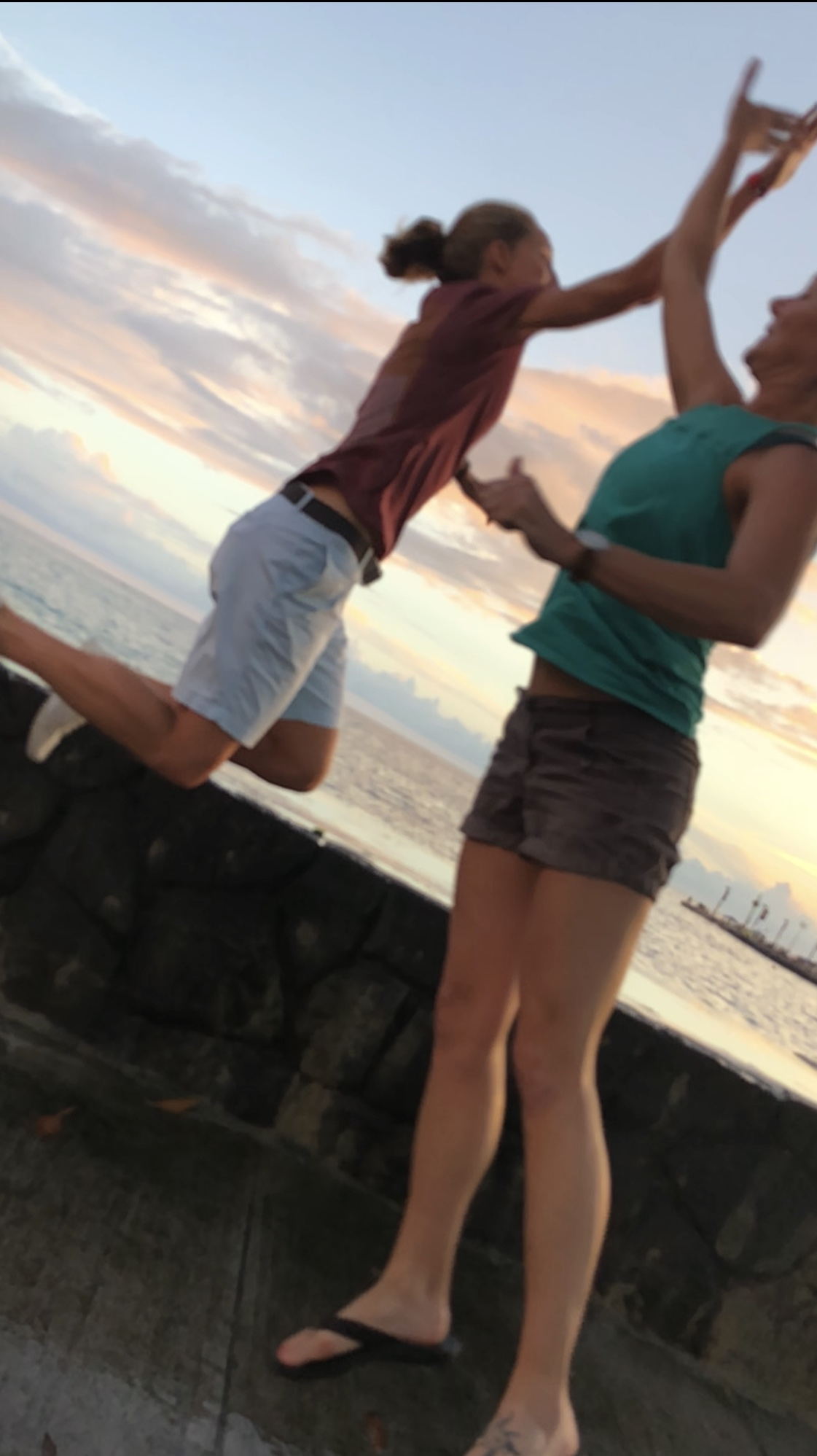 Hawaiian sunset high-five with my sister and team captain, Sarah Fox.