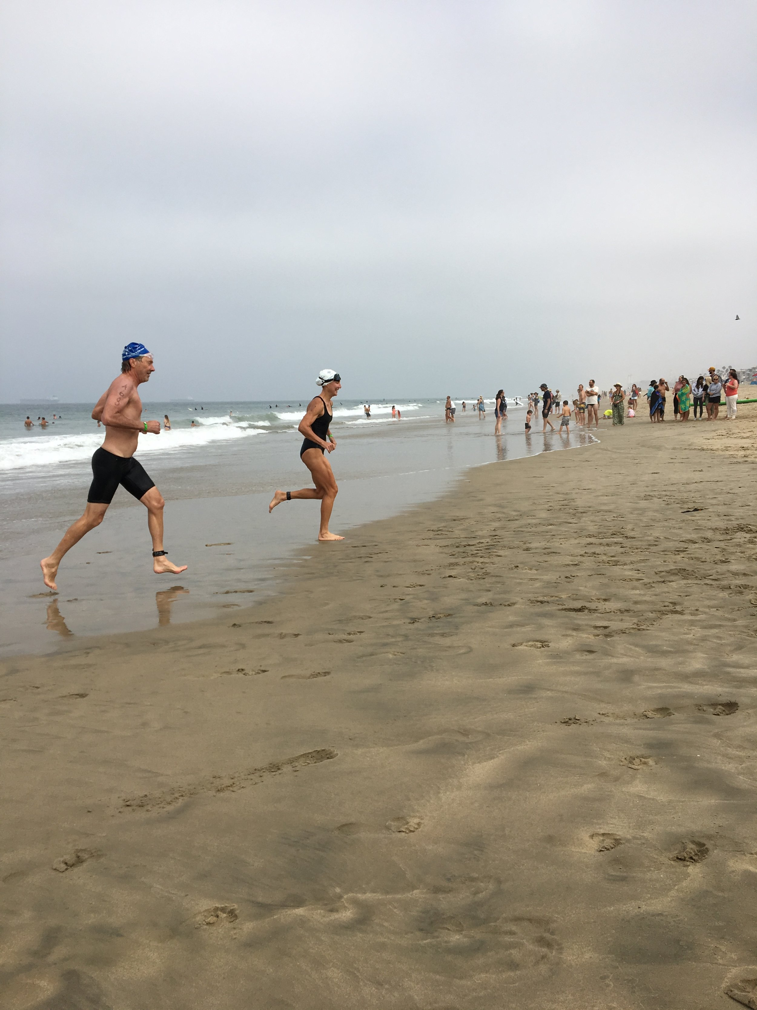 Exiting the water at the Pier To Pier race last Sunday. Photo courtesy of Hadara Katarski.