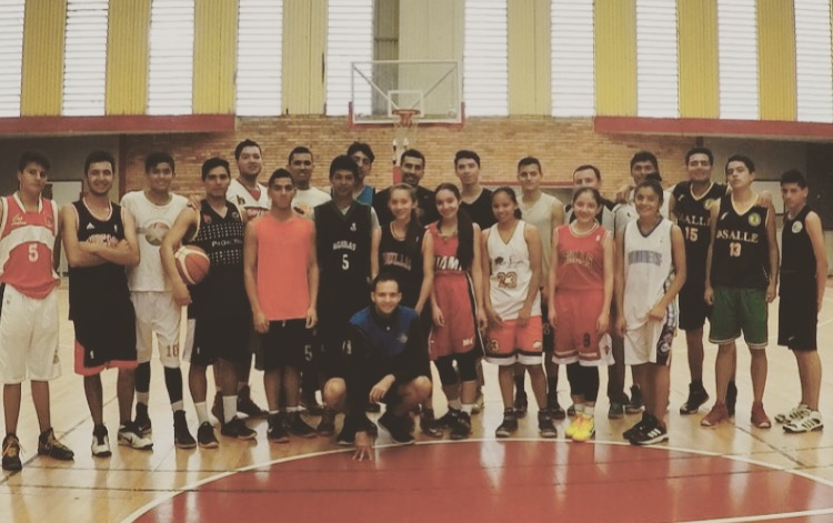 GZT's Jason Benadretti (center) with some members of the co-hosted camp with Aguilas de Tunja
