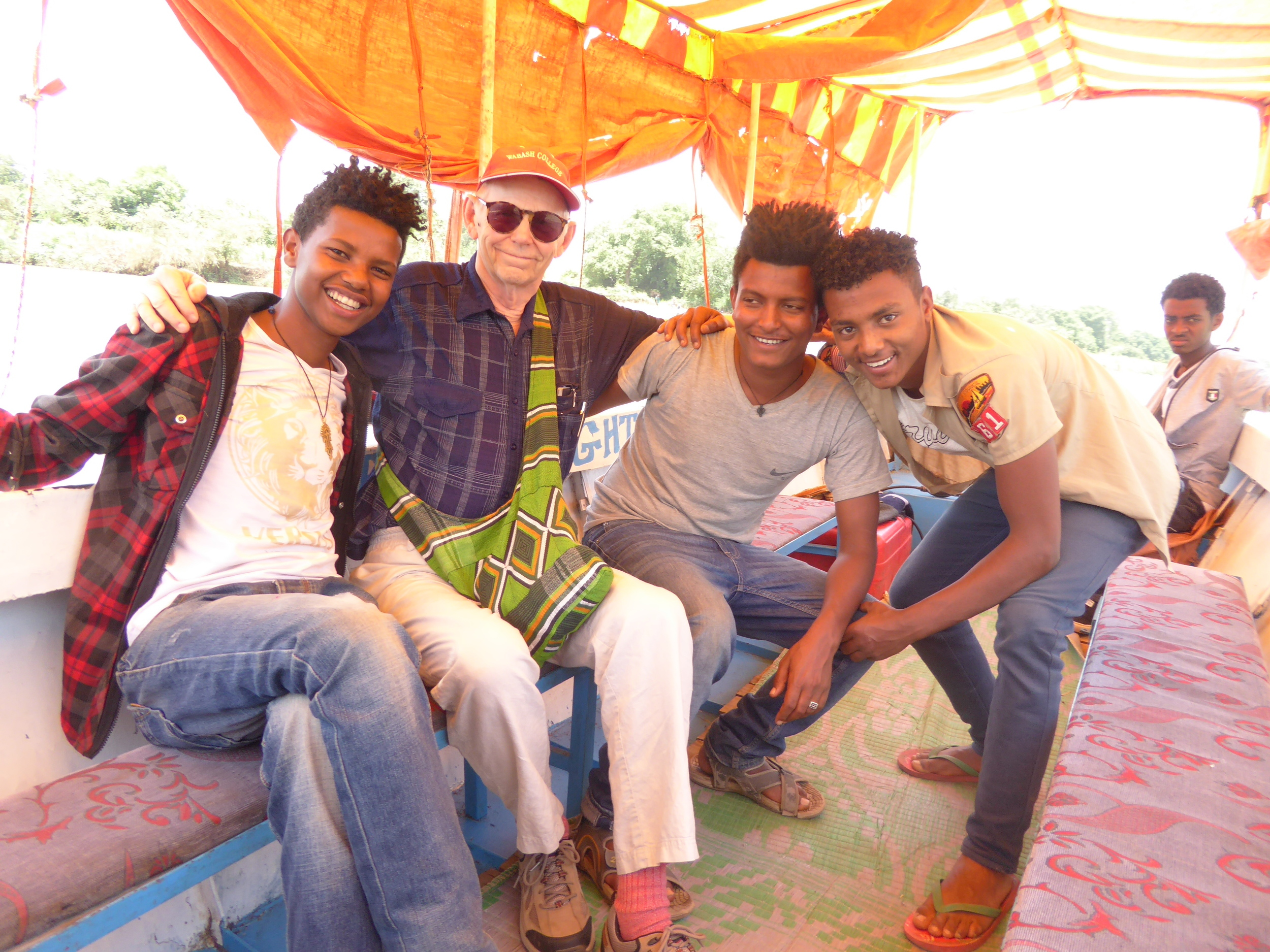Bill with Yohannes, Abu, and Mareg on an outing by boat to visit a monastery in Lake Tana near Bahar Dar.