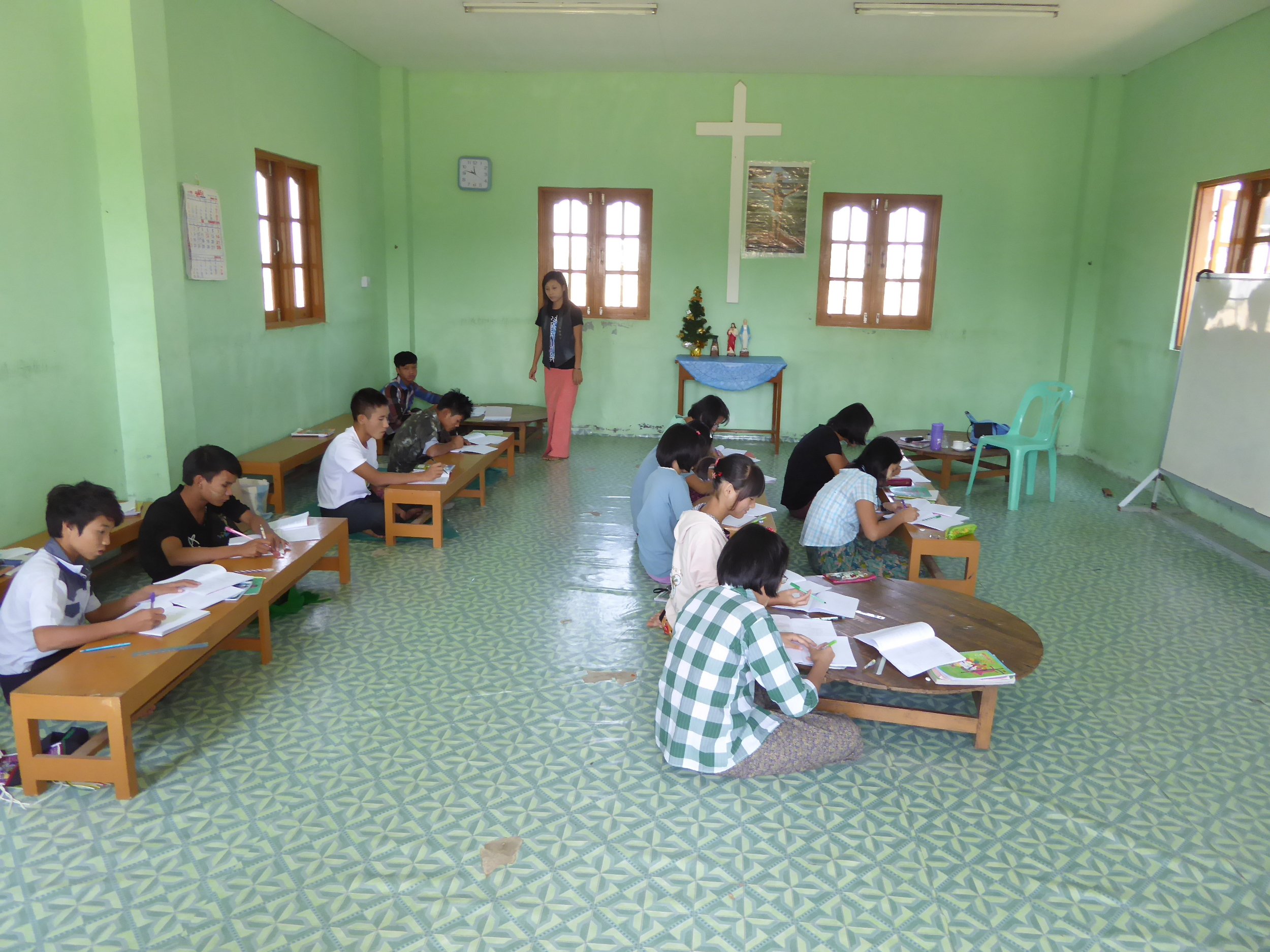 Children in the Christian study room (there is also a Buddhist study room) at the Dream Train orphanage outside Yangon, Myanmar.