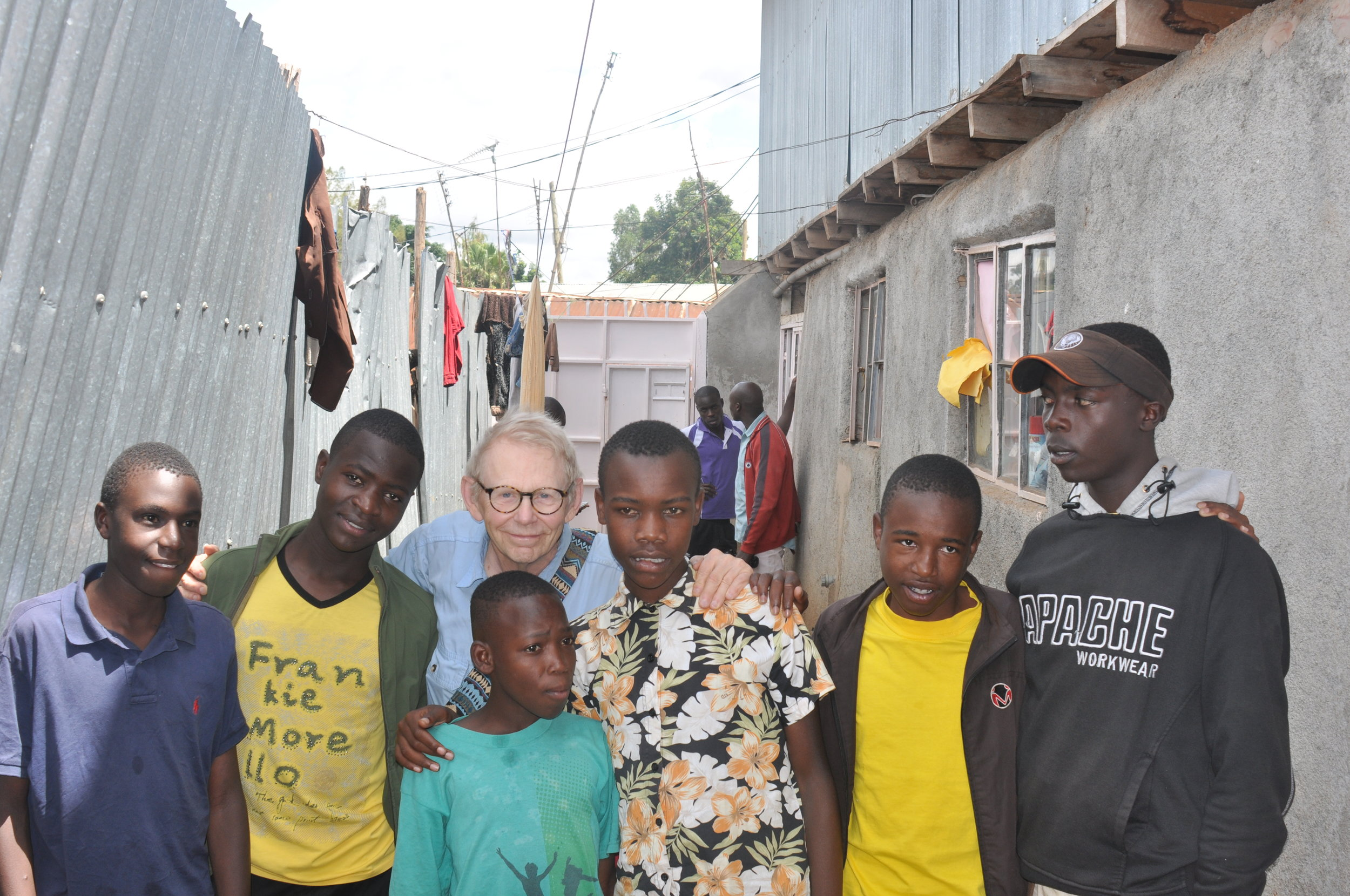 Some of the children served by Undugu Family in the Kibera slum of Nairobi.Their clothes are some sent from the US by various churches and civic organizations that hold clothing drives.