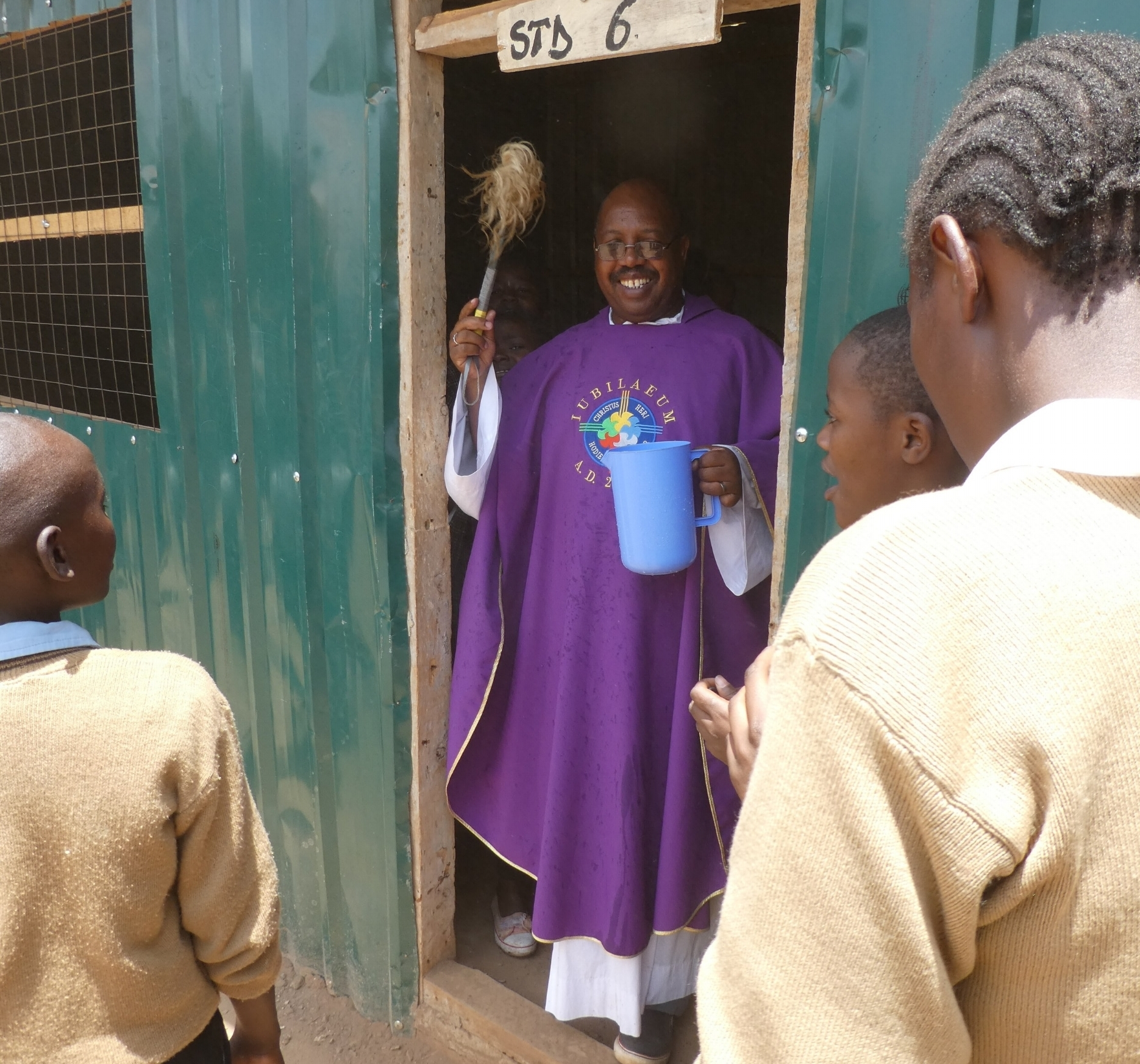 Father David Kamau blessing the new library and science lab