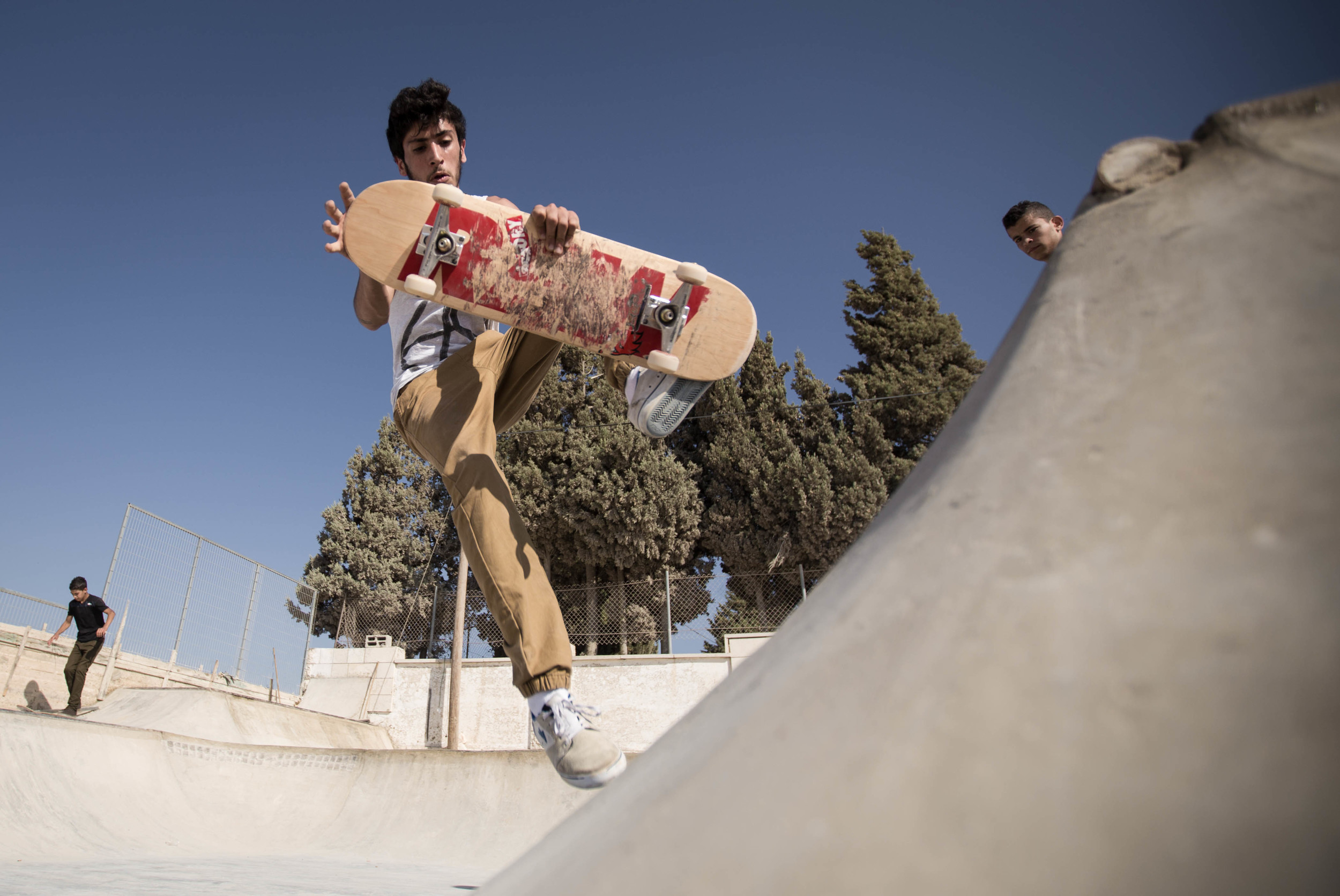 Aram tests out the mini-ramp at Rosa Park with a boneless, Asira Al-Shamaliya, 2015. Photo: Emil Agerskov