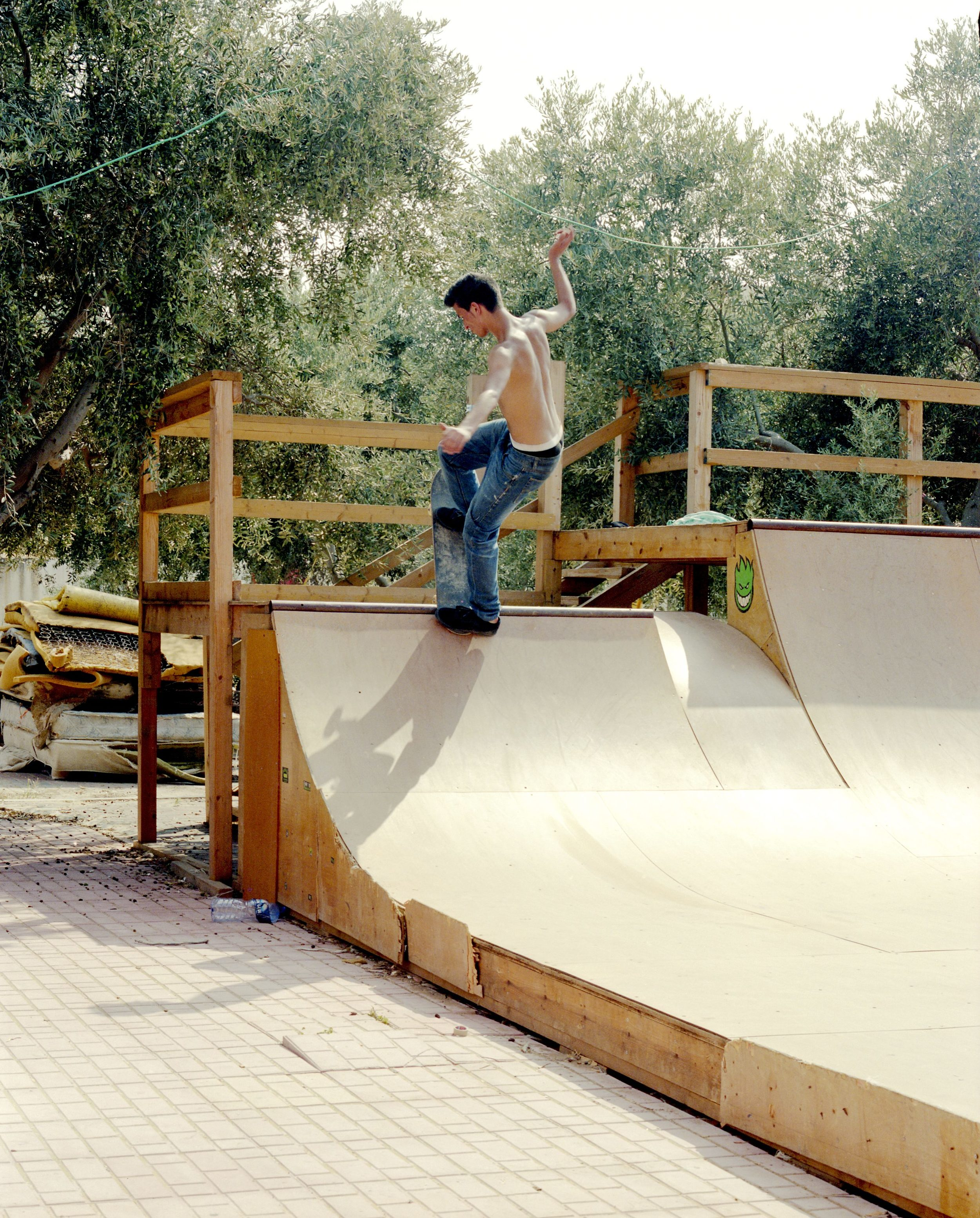Adham pulls a blunt-to-rock fakie at the Tashkeel ramp in Qalqilya.