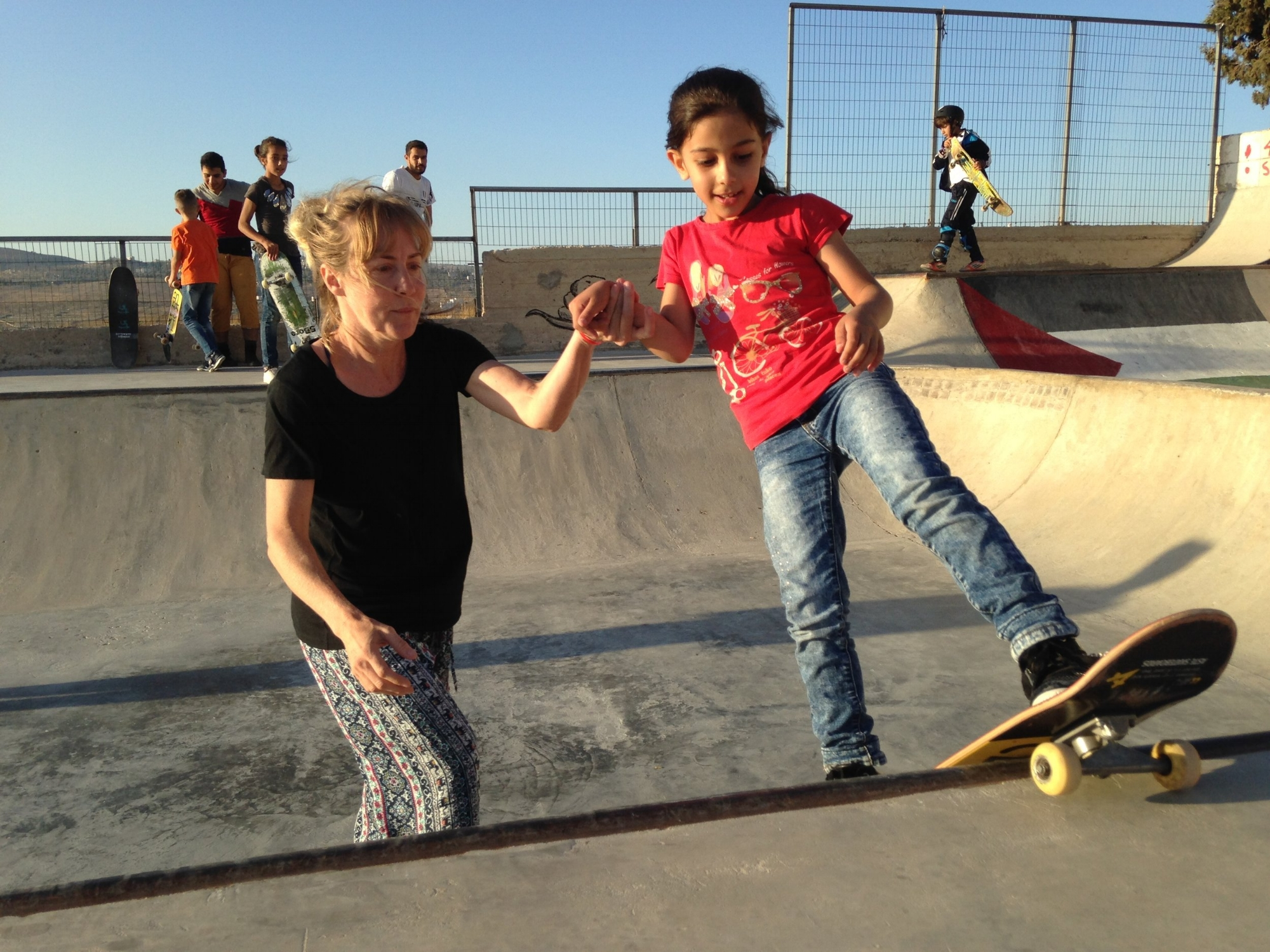 Kristi lends a helping hand to Lydia's rock-fakie.