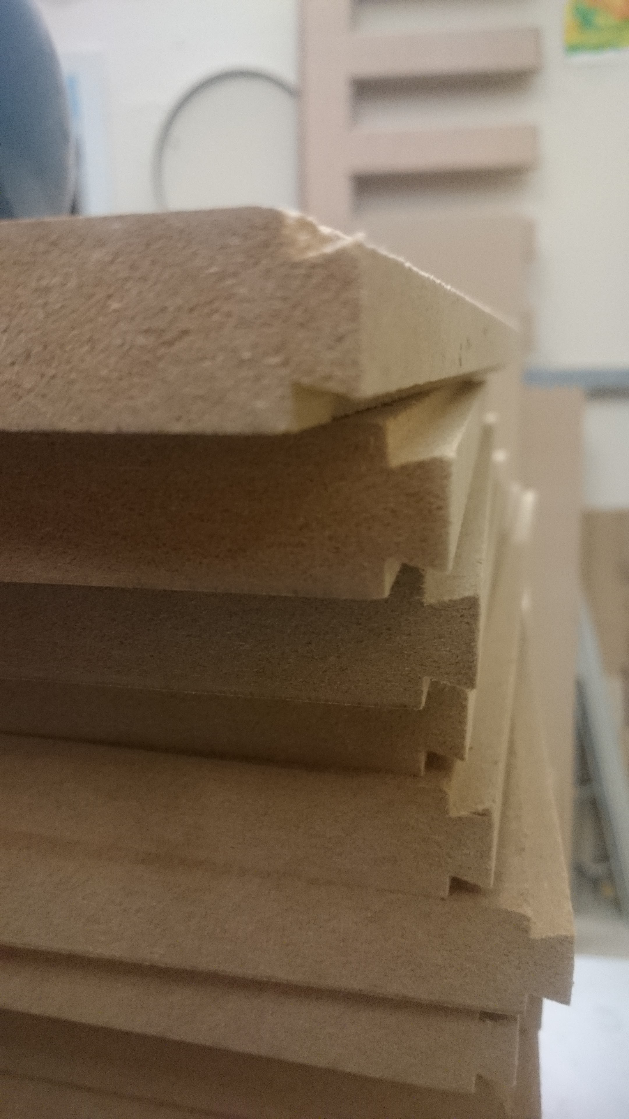 Shelves stacked together, all of the ends were cut on a router table, vertically against the fence. The fence is adjusted to get a tight fit through trial and error.