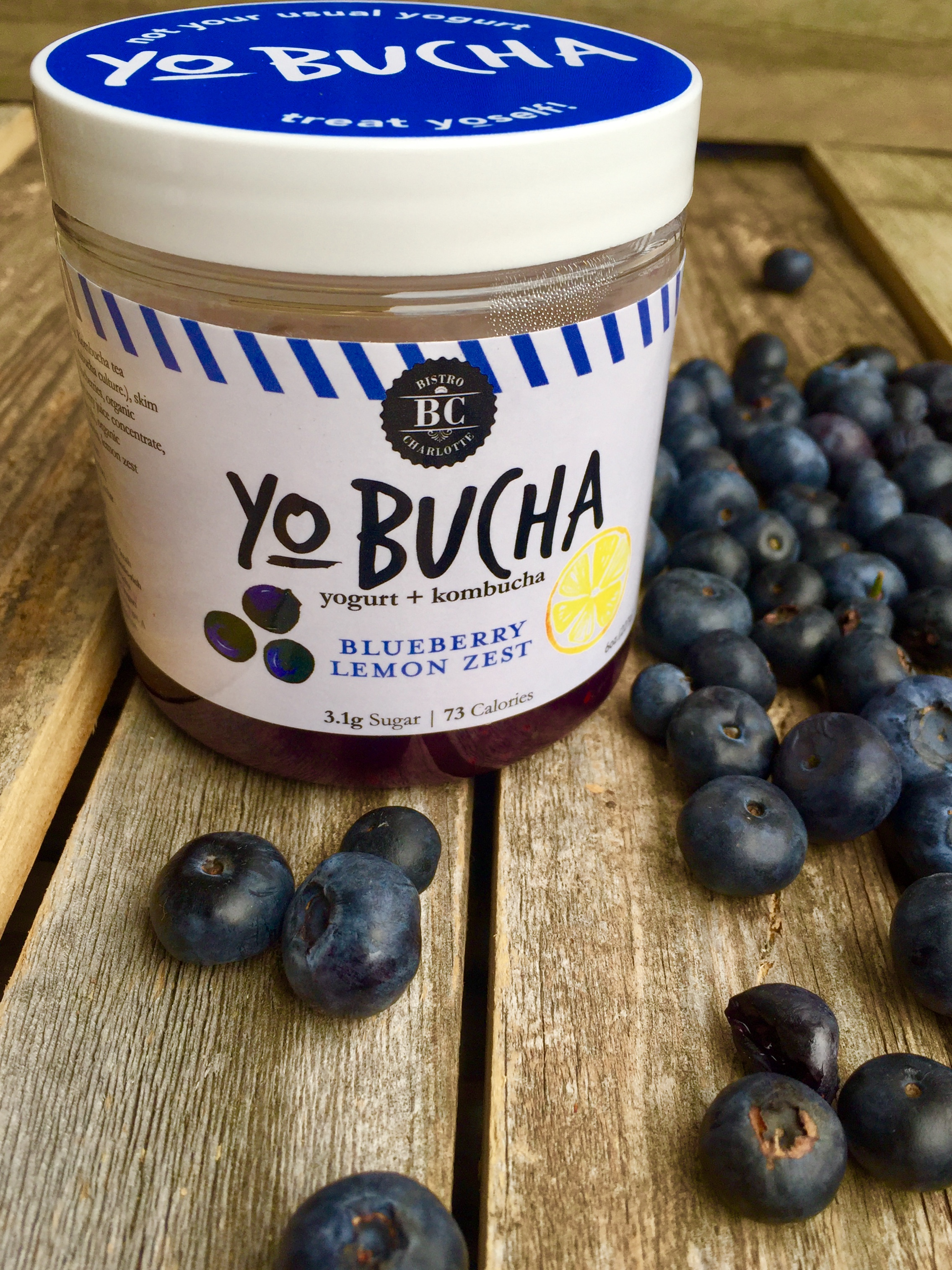 Blueberry Lemon Yo-Bucha - The perfect snack for getting you through that mid-morning slump! The bottom layer is sweet and tart, while the top layer is creamy and luscious. Bold blueberry and fresh lemon create a flavor that feels like tea-time in an English garden, no matter where you are!