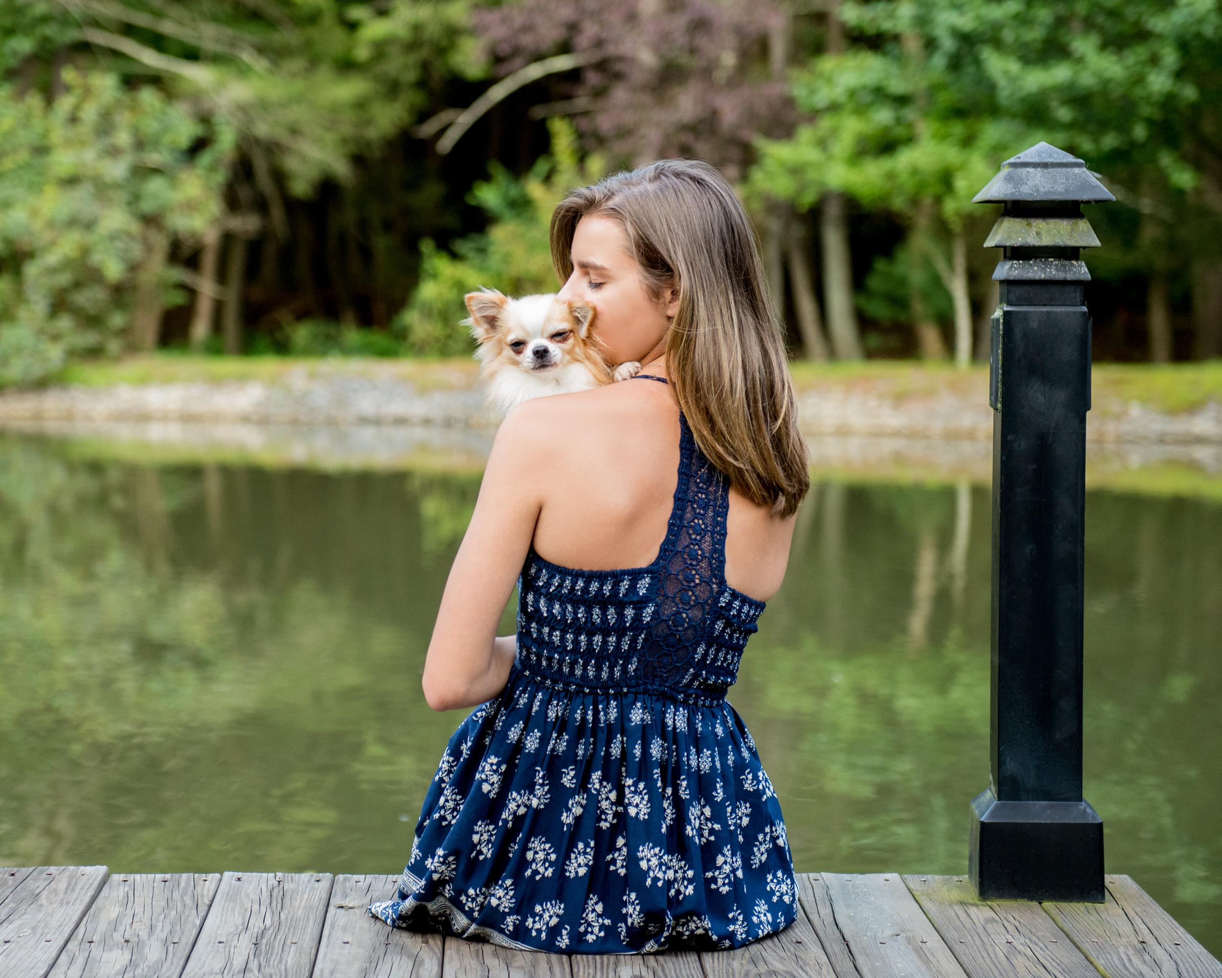 girl.holding.dog.pond.jpg
