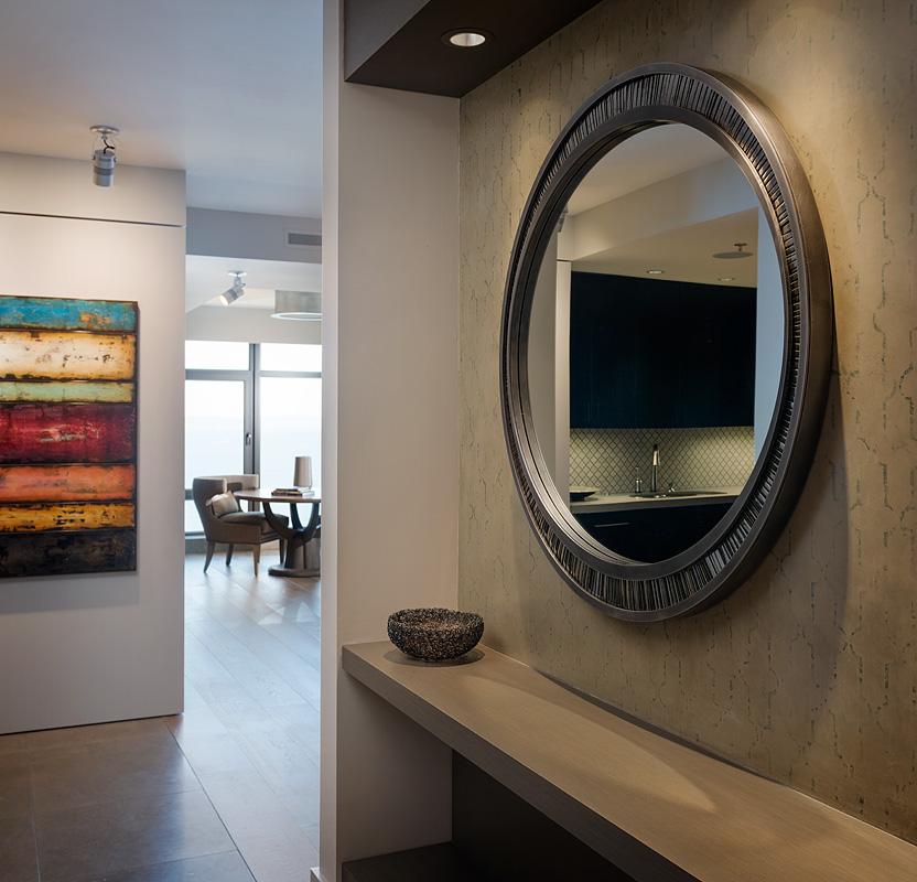 Modern Seattle condo remodel with custom mirror, plaster, tile and hardwood floors