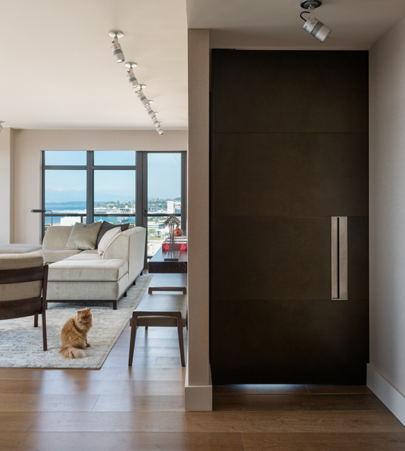 Full height leather wrapped door with custom fabricated metal pull for Master Bedroom Remodel