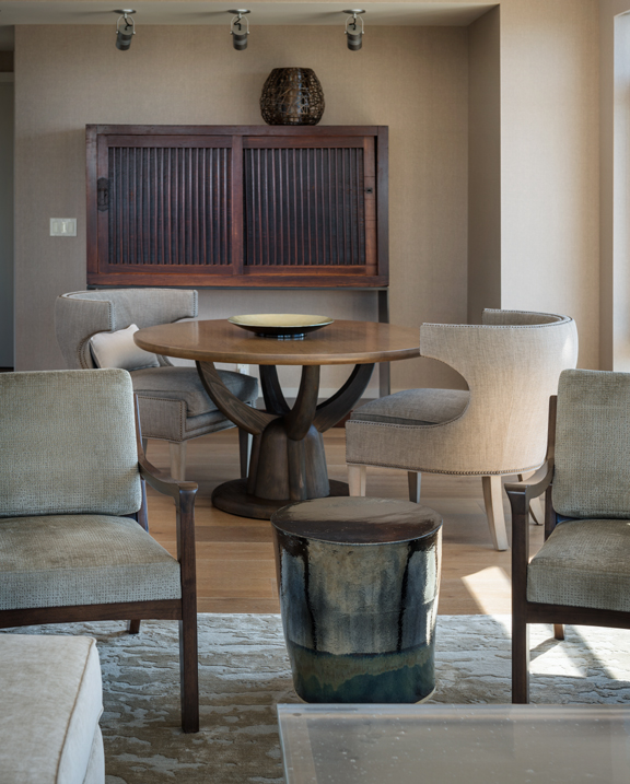 Seattle Custom Living Room Design with cool table unique light fixture and architectural chairs