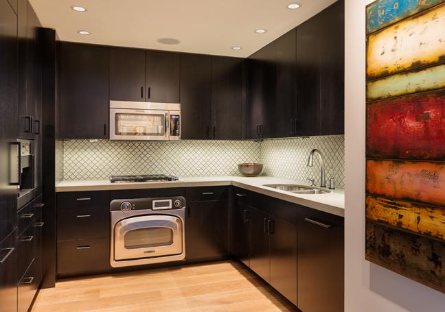 Modern Seattle Kitchen Remodel with cool splash, dark cabinets and hardwood floors