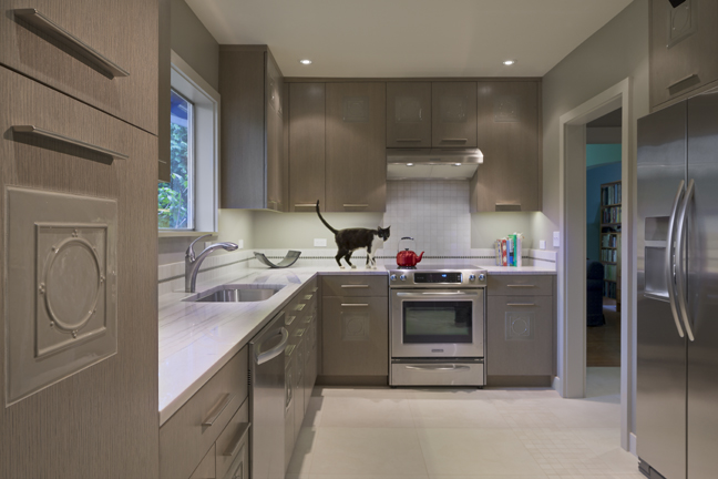 Seattle Kitchen Remodel with new back splash, counters and custom inlay oak cabinets and a cat on the counter
