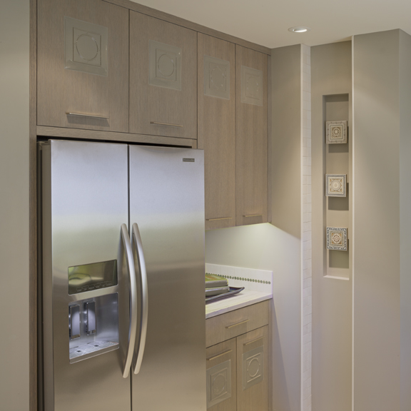 Seattle Washington Kitchen Remodel with stainless steel refrigerator custom art niche with tiles from traveling, and custom inlay cabinets