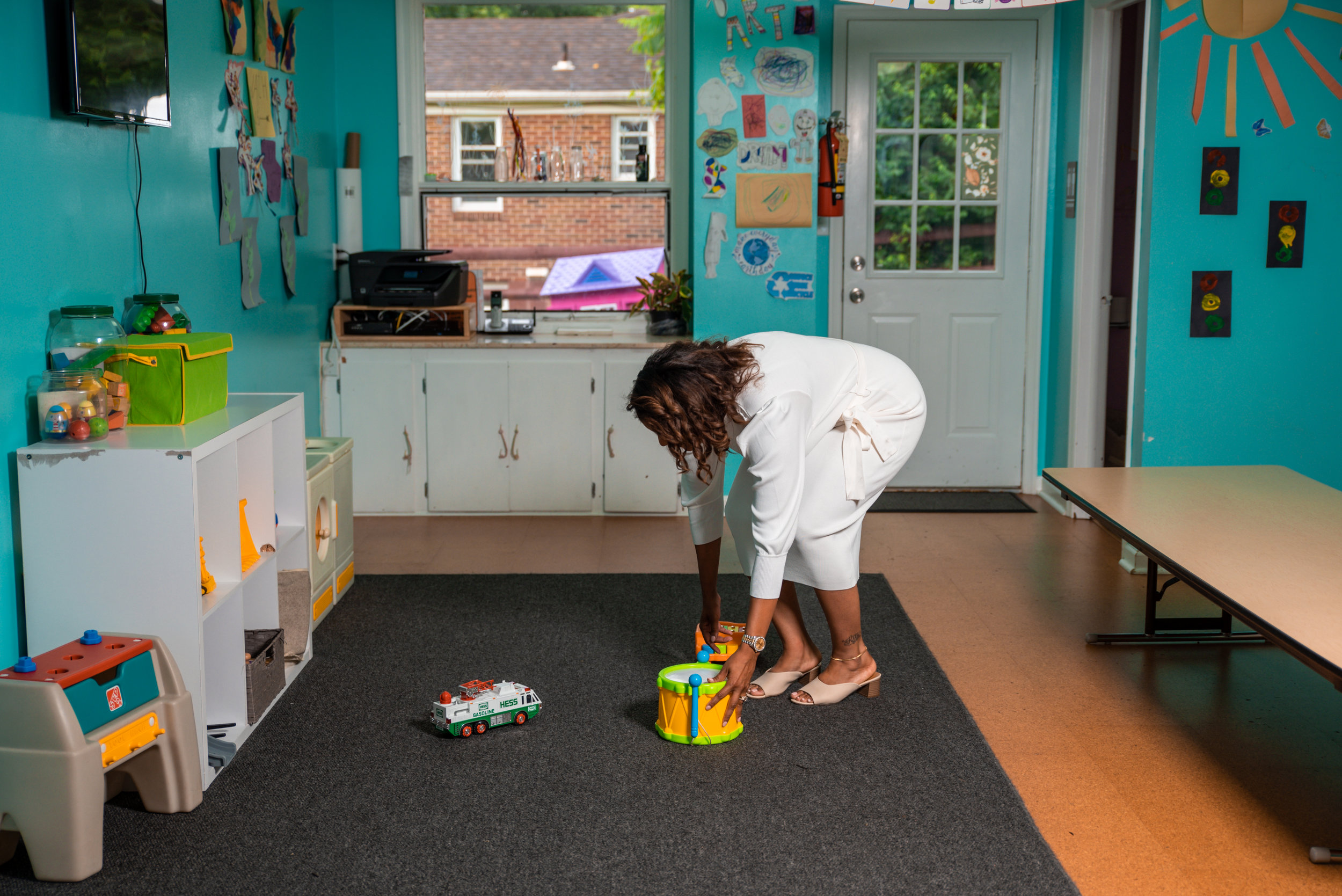 Karlena Cleaning up some toys left behind
